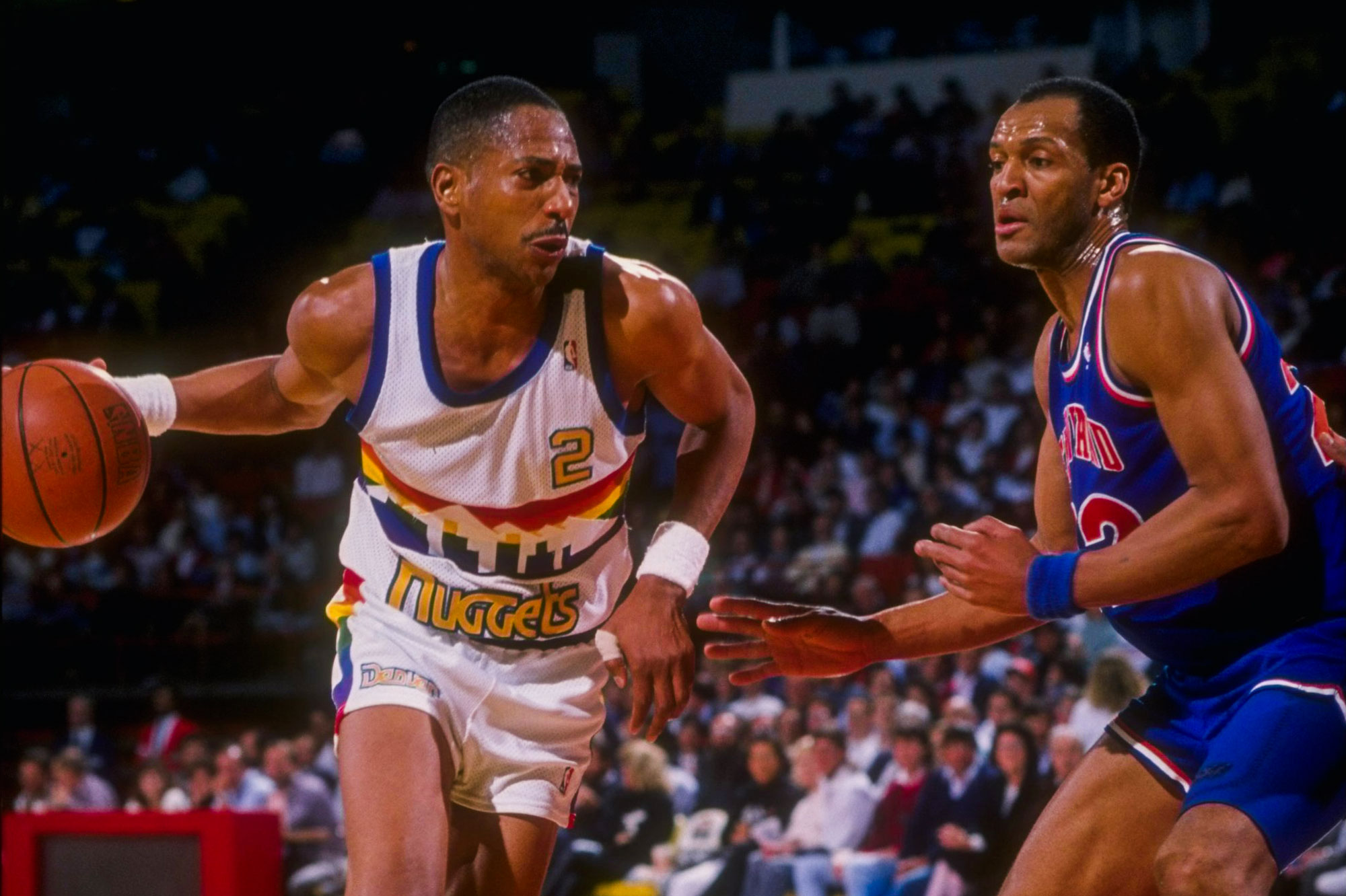 <p>Alex English of the Denver Nuggets moves the ball during a game versus the Cleveland Cavaliers during the 1989-1990 season at the McNichols Sports Arena in Denver, Colo.</p>
