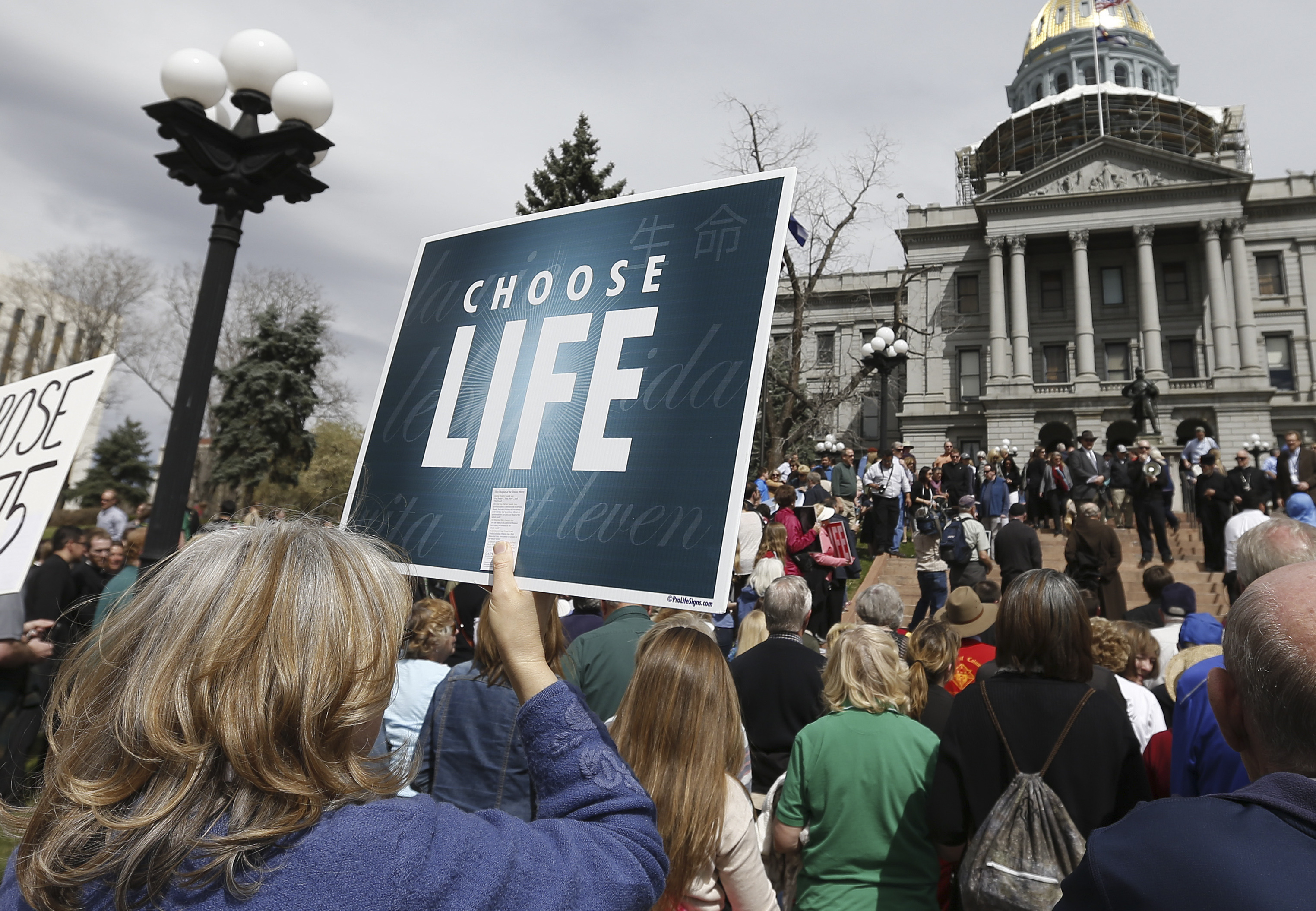 <p>In a file photo, anti-abortion protesters rally  on the steps of the state Capitol in Denver in April 2014.</p>