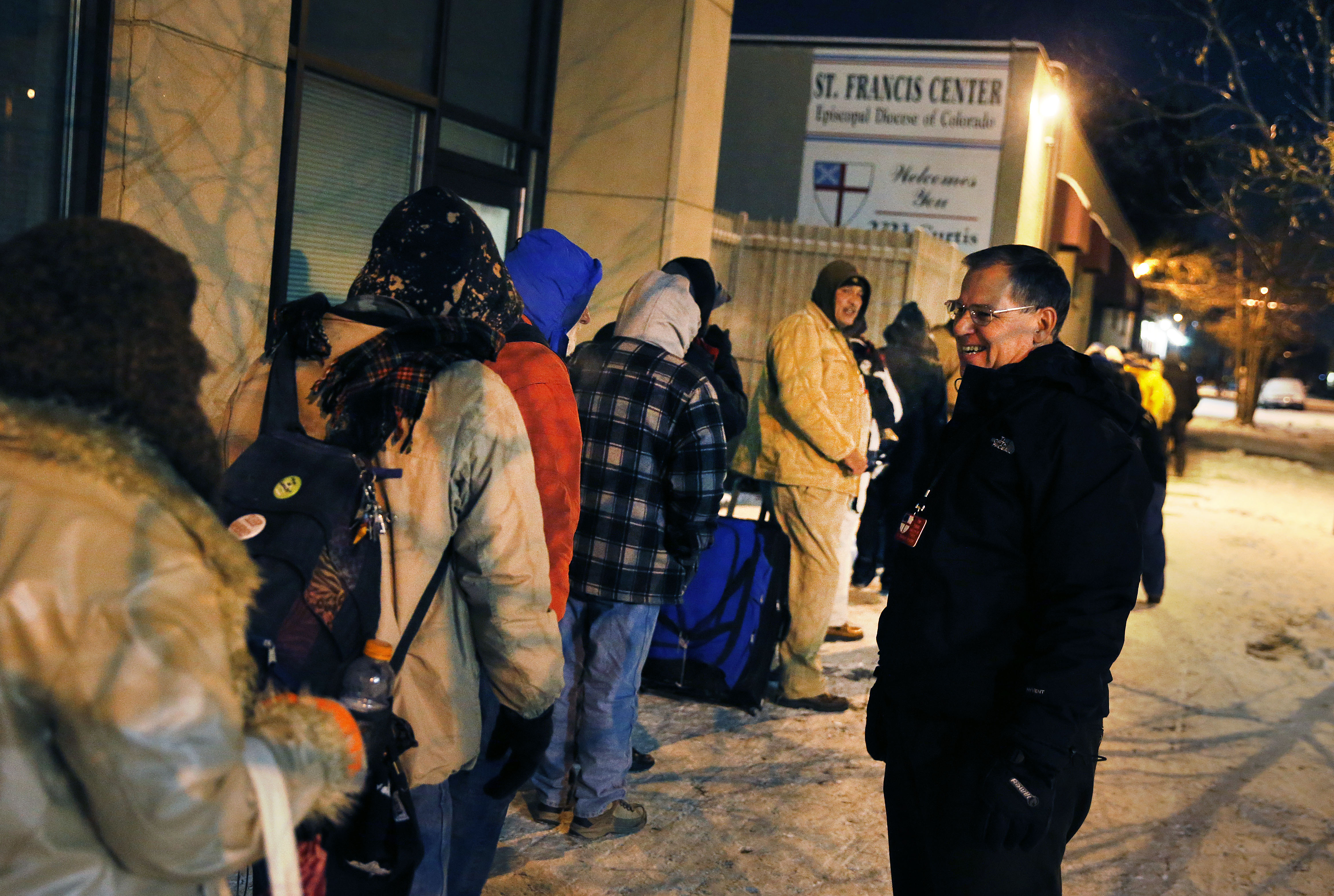 <p>In this Dec. 5, 2013 file photo, Tom Tuning, right, greets homeless men who wait for the opening of the St. Francis Center's day shelter, where Tuning works, in downtown Denver.</p>
