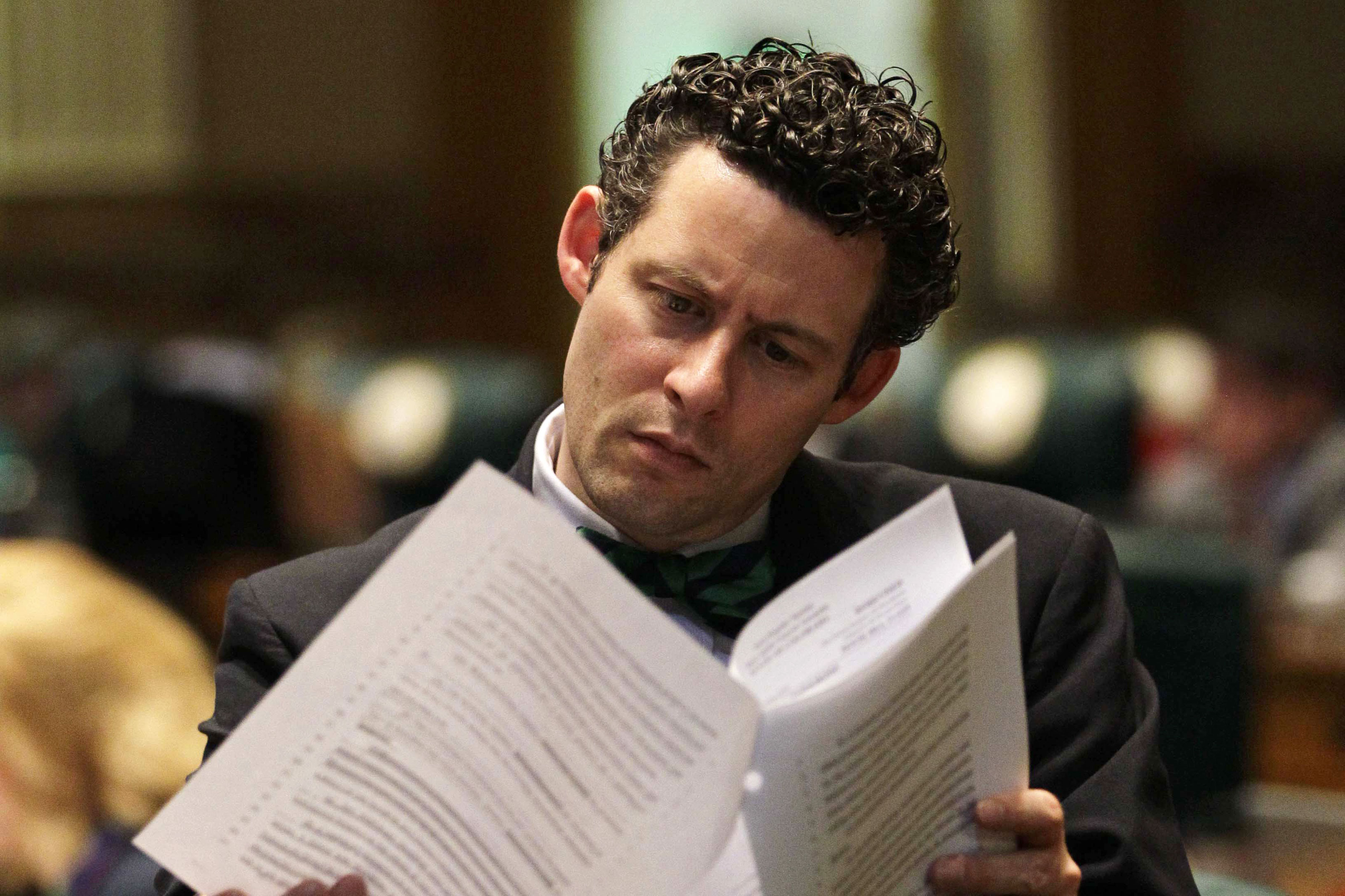 <p>Colorado State Rep. Justin Everett, R-Littleton, reads paperwork during a debate period inside the Legislature, March 15, 2013.</p>
