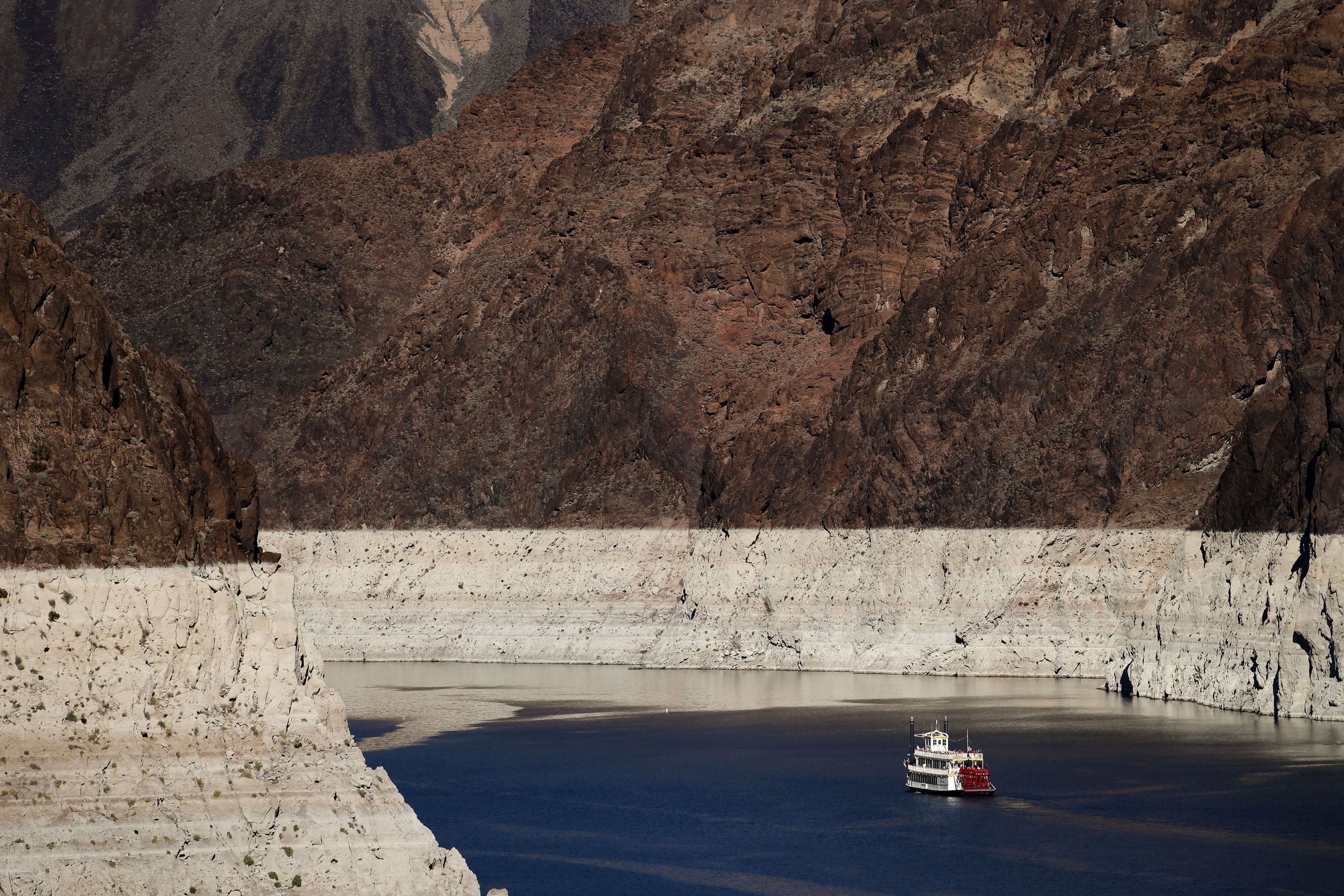 <p>A riverboat glides through Lake Mead on the Colorado River at Hoover Dam near Boulder City, Nev., in this photo from October 2015.</p>