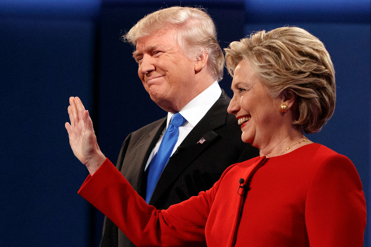 <p>Republican presidential candidate Donald Trump, left, stands with Democratic candidate Hillary Clinton at the first presidential debate at Hofstra University, Sept. 26, 2016.</p>