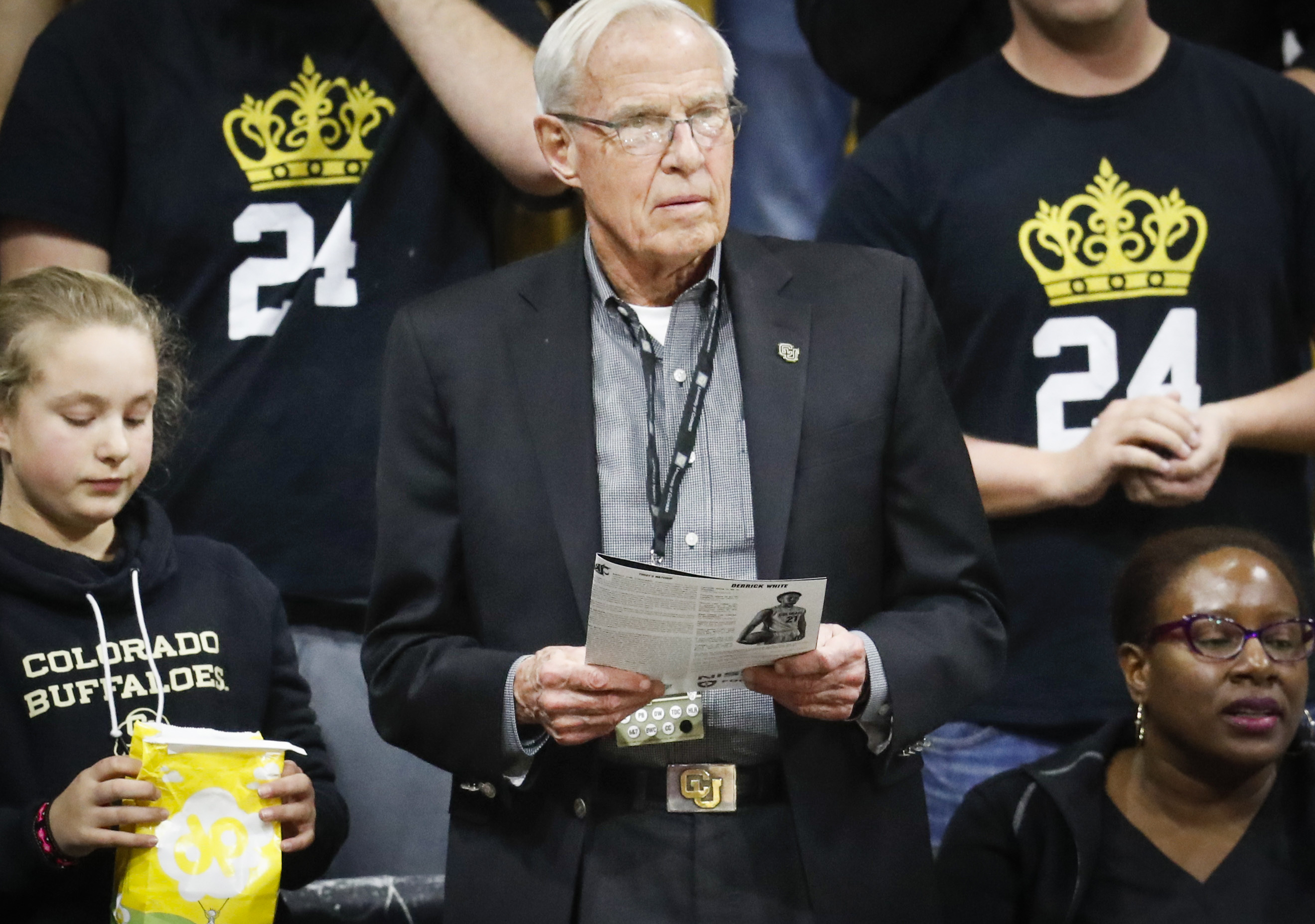 <p>Bruce Benson, center, president of the University of Colorado, looks on from a court side seat as Colorado hosts Washington State in the first half of an NCAA college basketball game in February 2017.</p>