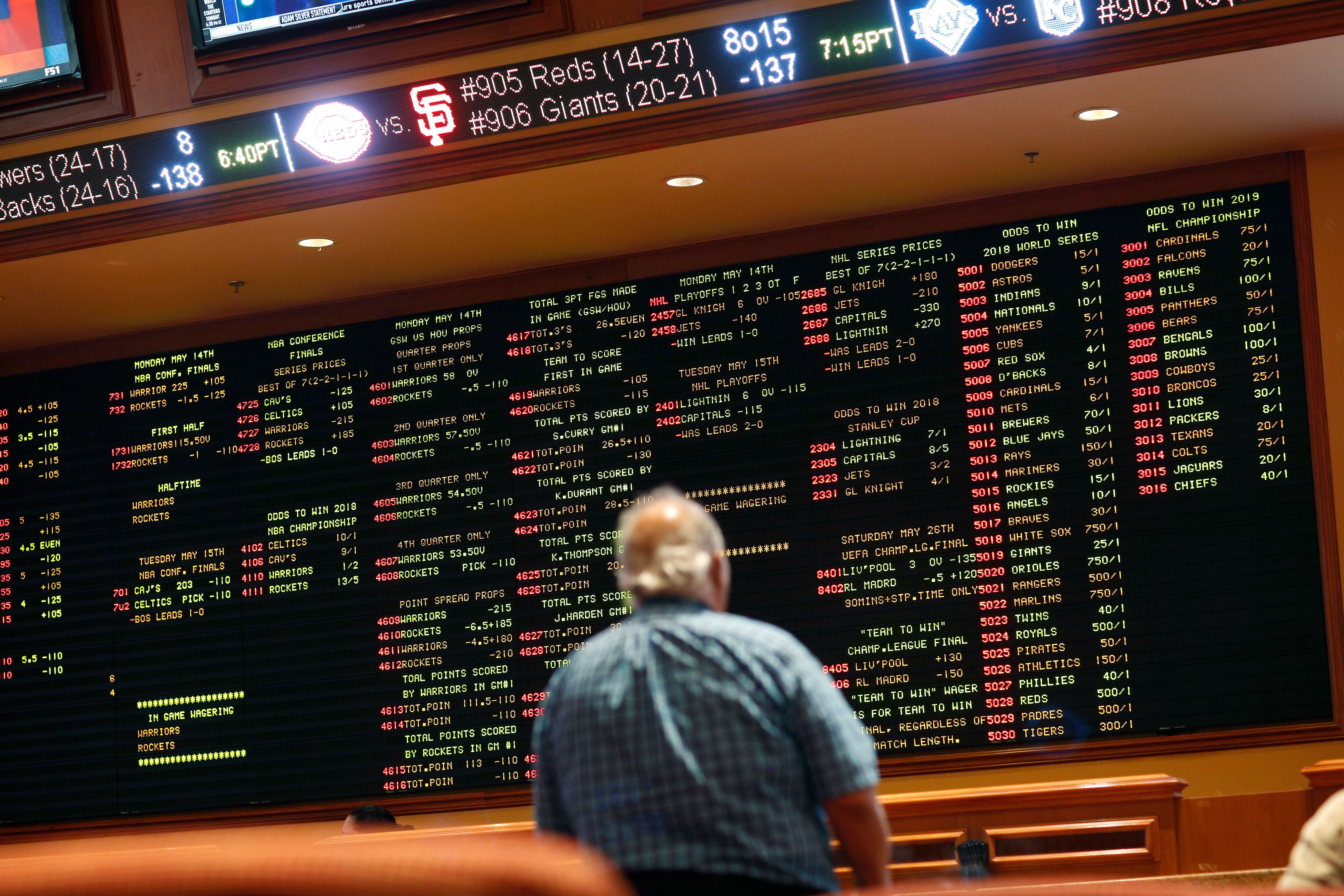 <p>Betting odds are displayed on a board in the sports book at the South Point hotel and casino in Las Vegas, May 14, 2018.</p>