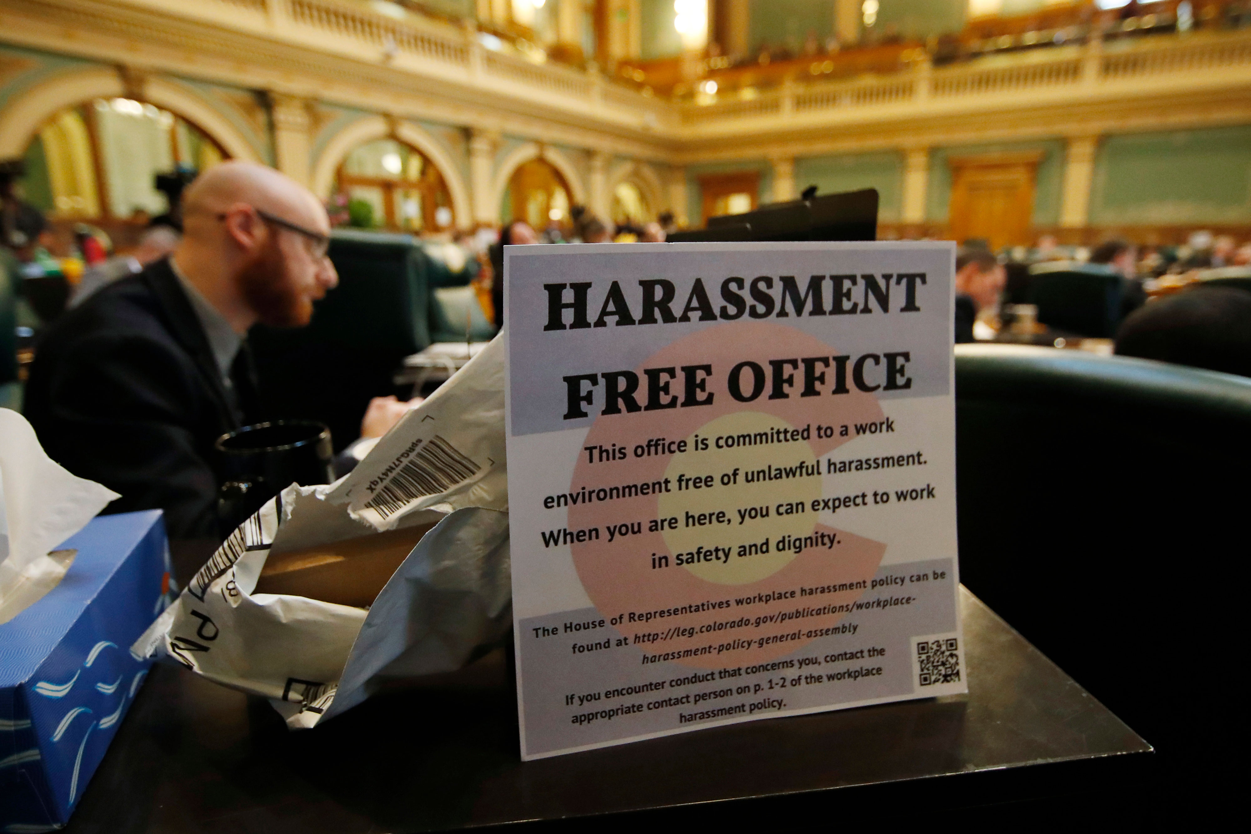 <p>A sign sits on the filing cabinet next to Colorado State Rep. Jonathan Singer, D-Longmont, during debate to expel State Rep. Steve Lebsock, D-Thornton, over sexual misconduct allegations from his peers in the State Capitol, March 2, 2018.</p>