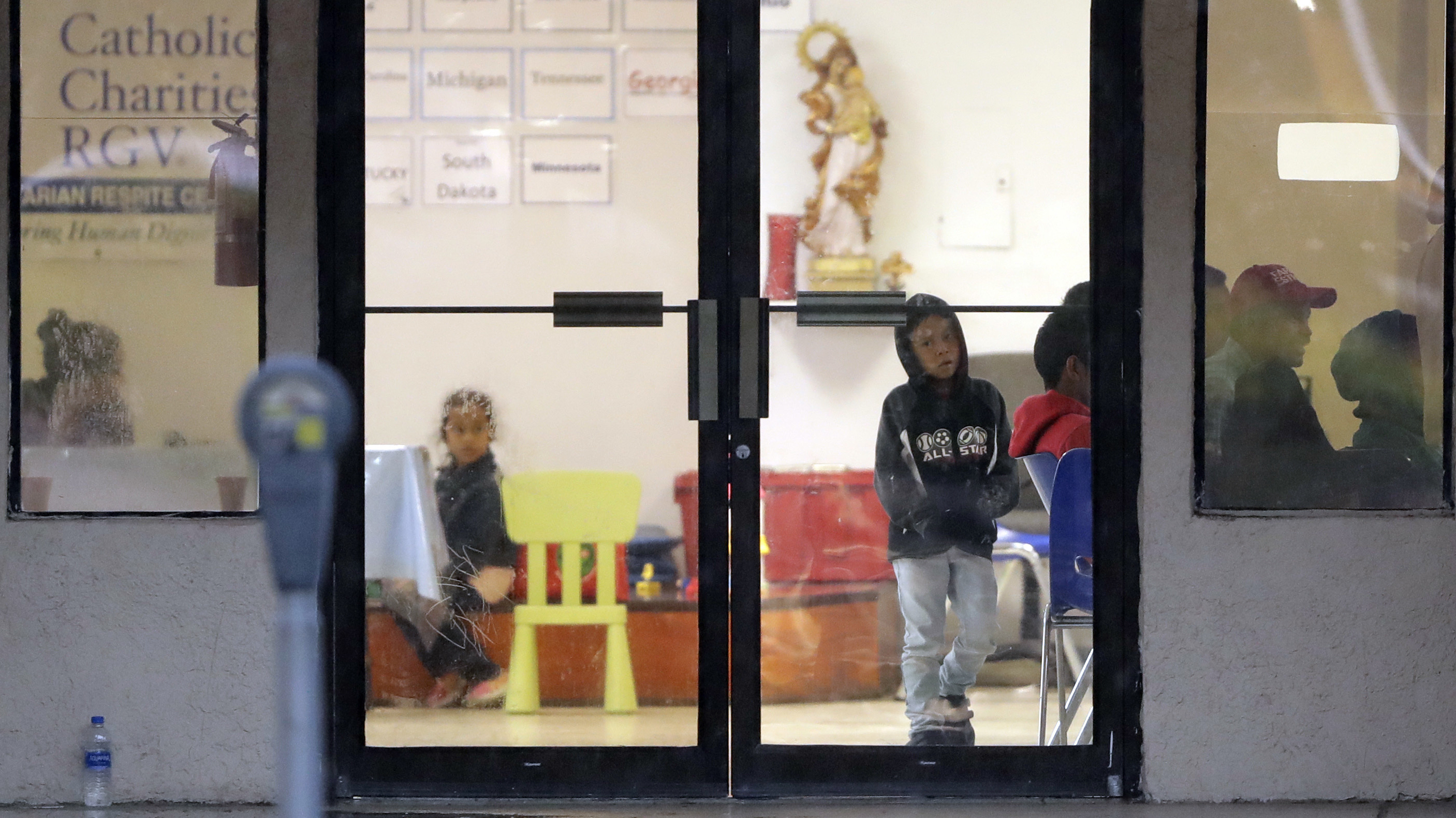 <p>Immigrants recently processes and released by U.S. Customs and Border Protection wait at the the Catholic Charities RGV, Wednesday, June 20, 2018, in McAllen, Texas.</p>
