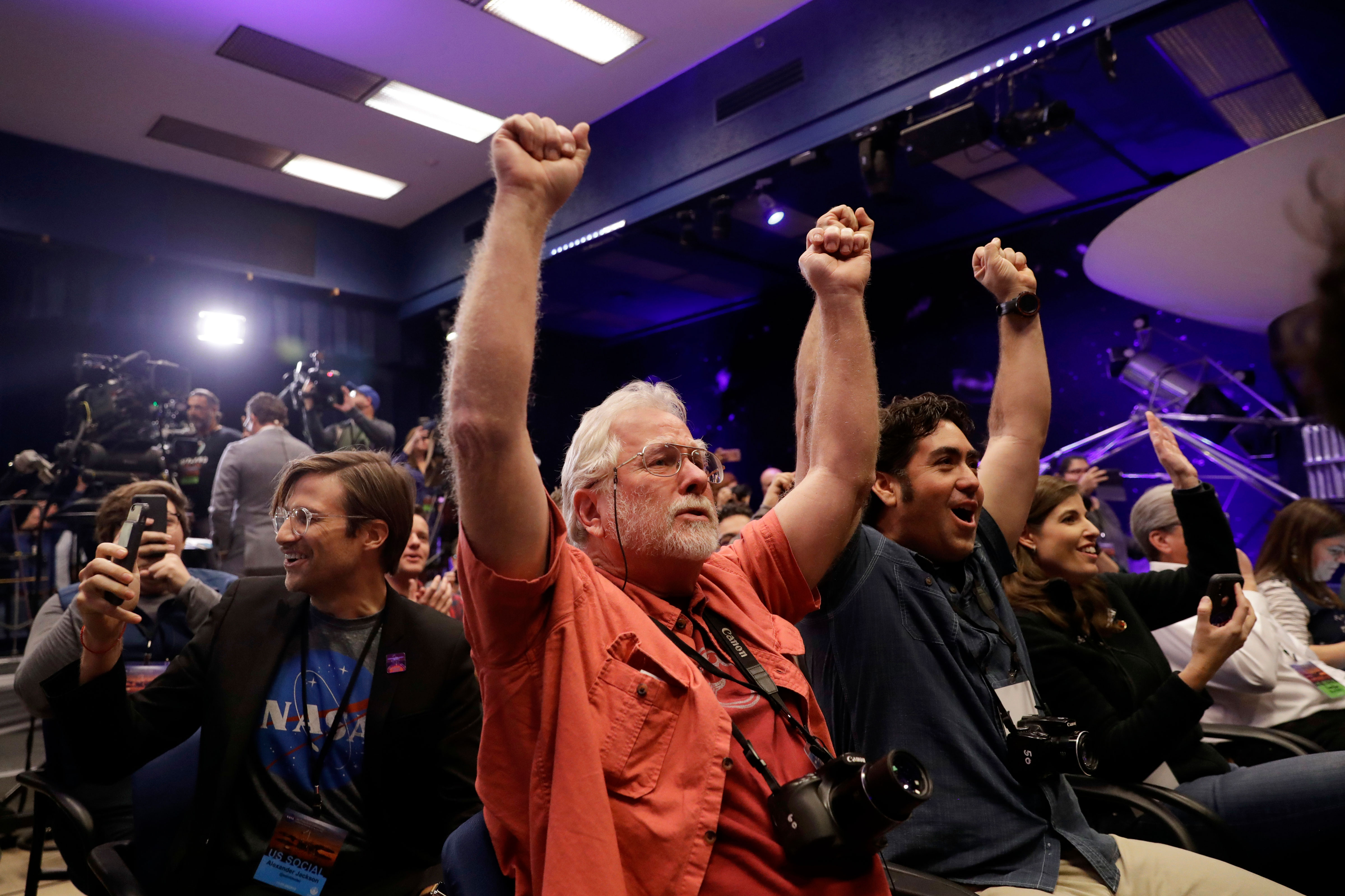 <p>People at NASA's Jet Propulsion Laboratory in Pasadena, Calif., celebrate as the InSight lander touches down on Mars on Monday, Nov. 26, 2018. </p>
