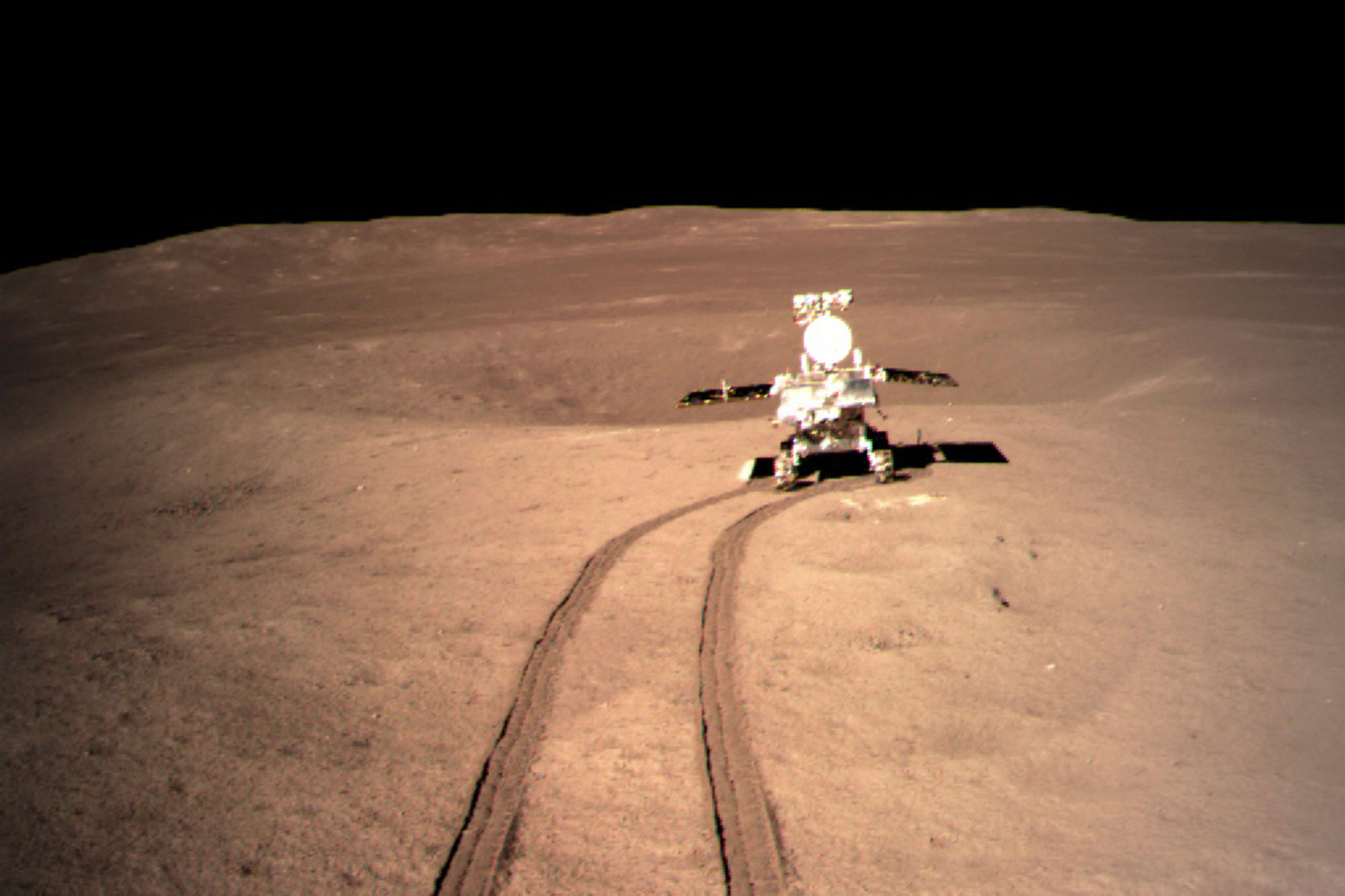 <p>In this photo provided on Jan. 4, 2019, by China National Space Administration via Xinhua News Agency, Yutu-2, China's lunar rover, leaves wheel marks after leaving the lander that touched down on the surface of the far side of the moon.</p>