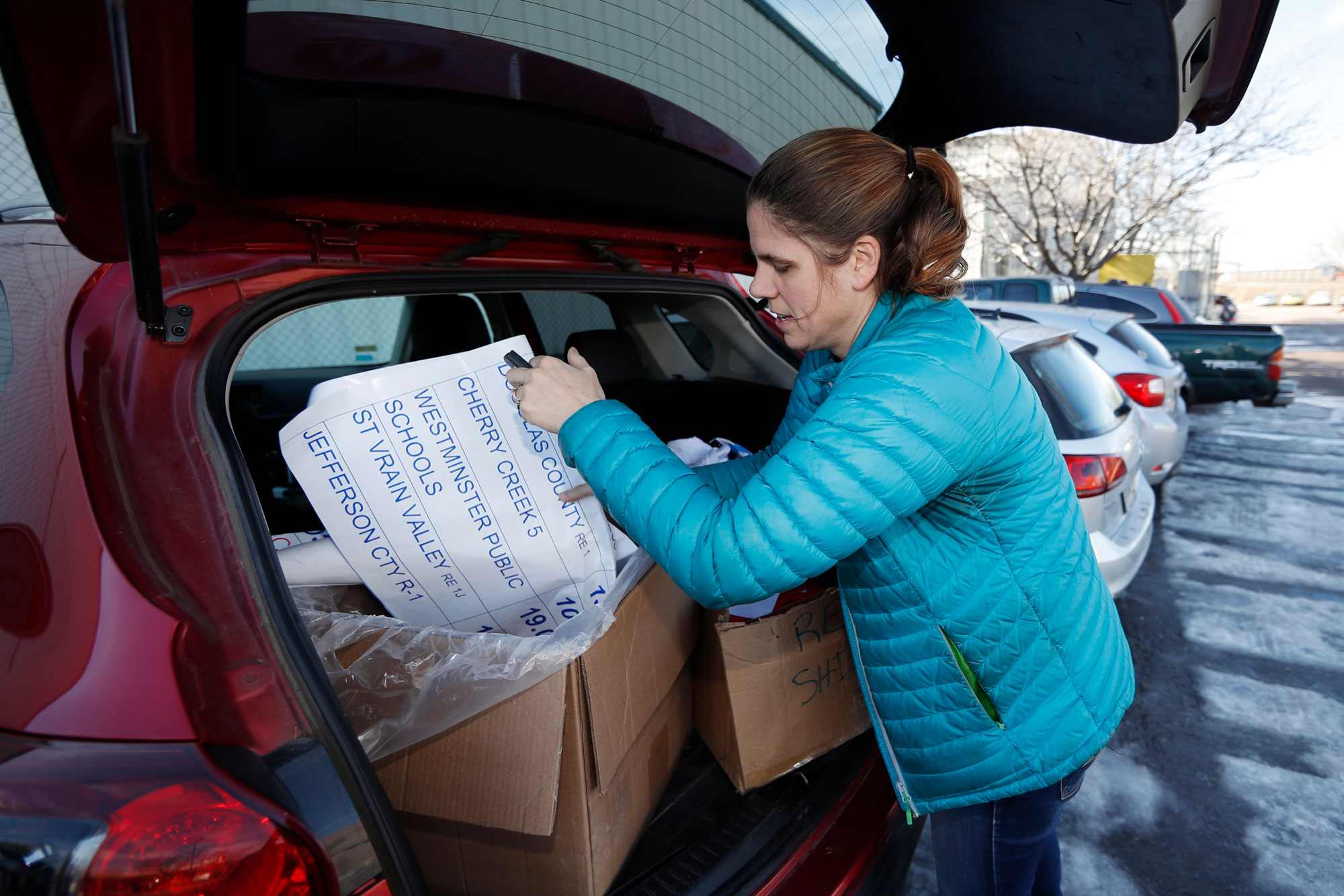 <p>In this Thursday, Jan. 17, 2019, photograph, Kate Martin, a former teacher and current employee of the Denver Classroom Teachers Association, unloads items for a potential teachers' strike outside the union's headquarters in south Denver.</p>