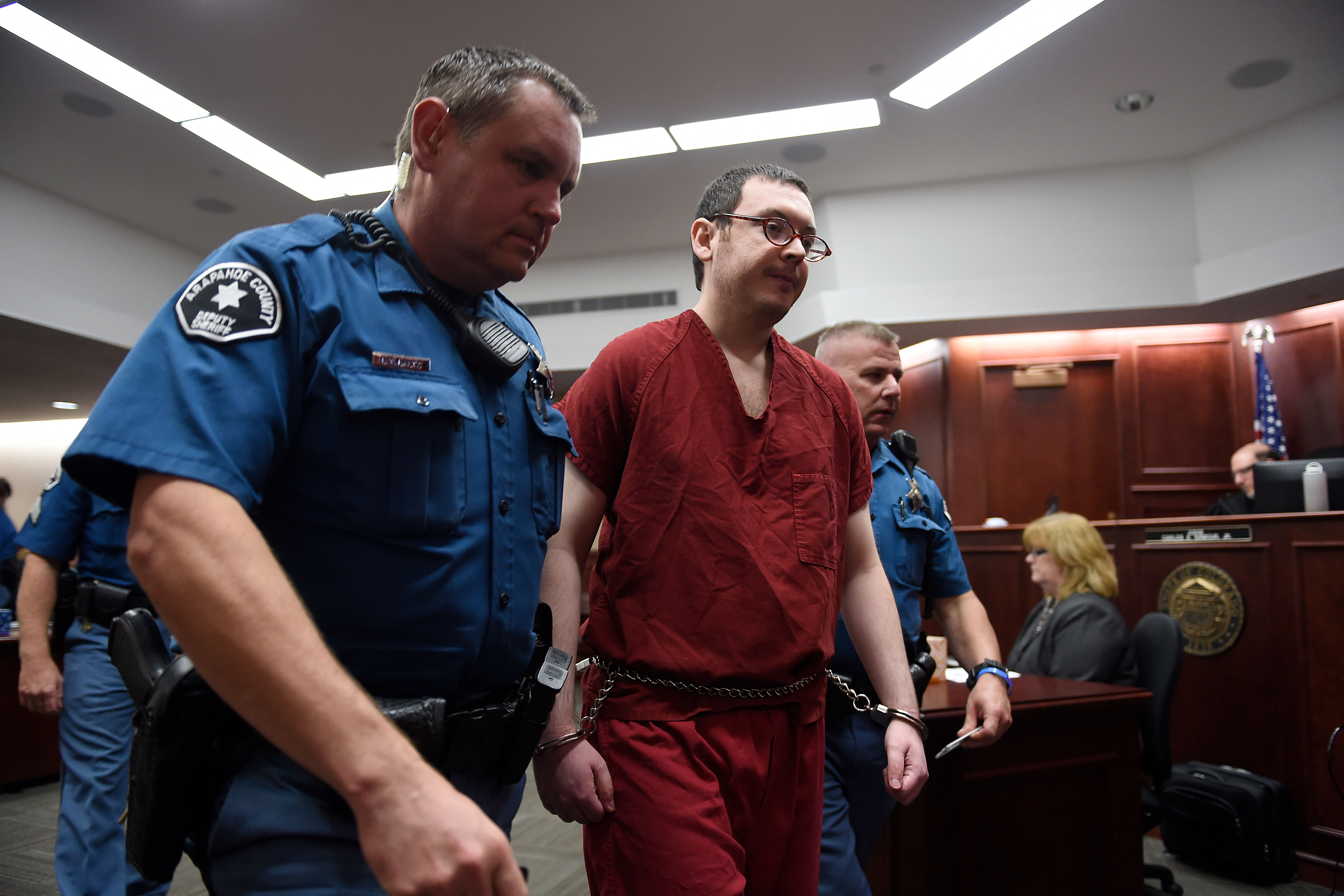 <p>Colorado theater shooter James Holmes is led out of the courtroom after sentencing, Aug. 26, 2015 in Centennial, Colo. Holmes was sentenced to life in prison without parole by Judge Carlos Samour Jr.</p>