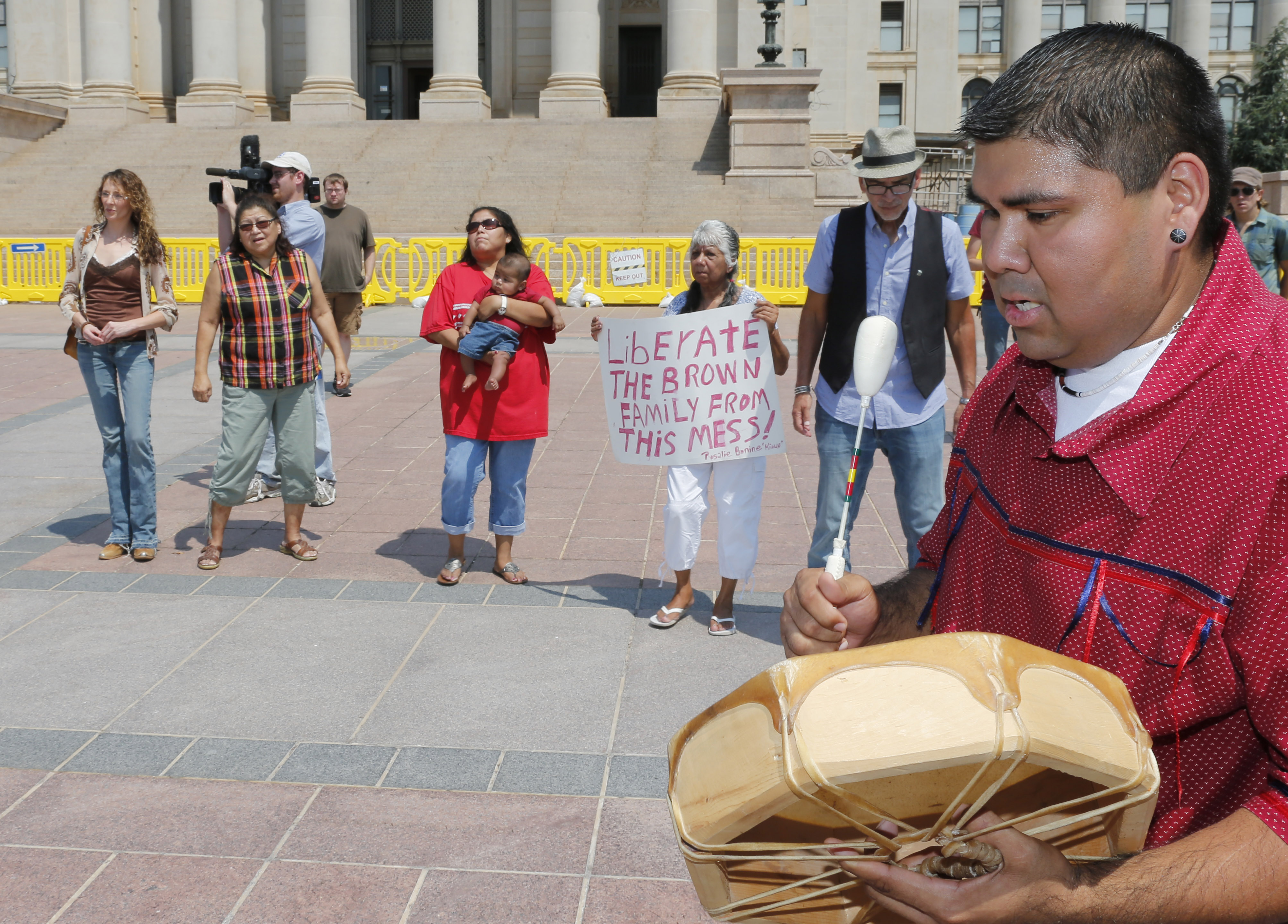<p>Chebon Kernell beats a drum and sings as participants dance during a rally in support of three-year-old baby Veronica, Veronica's biological father, Dusten Brown, and the Indian Child Welfare Act, in Oklahoma City, Monday, Aug. 19, 2013.</p>