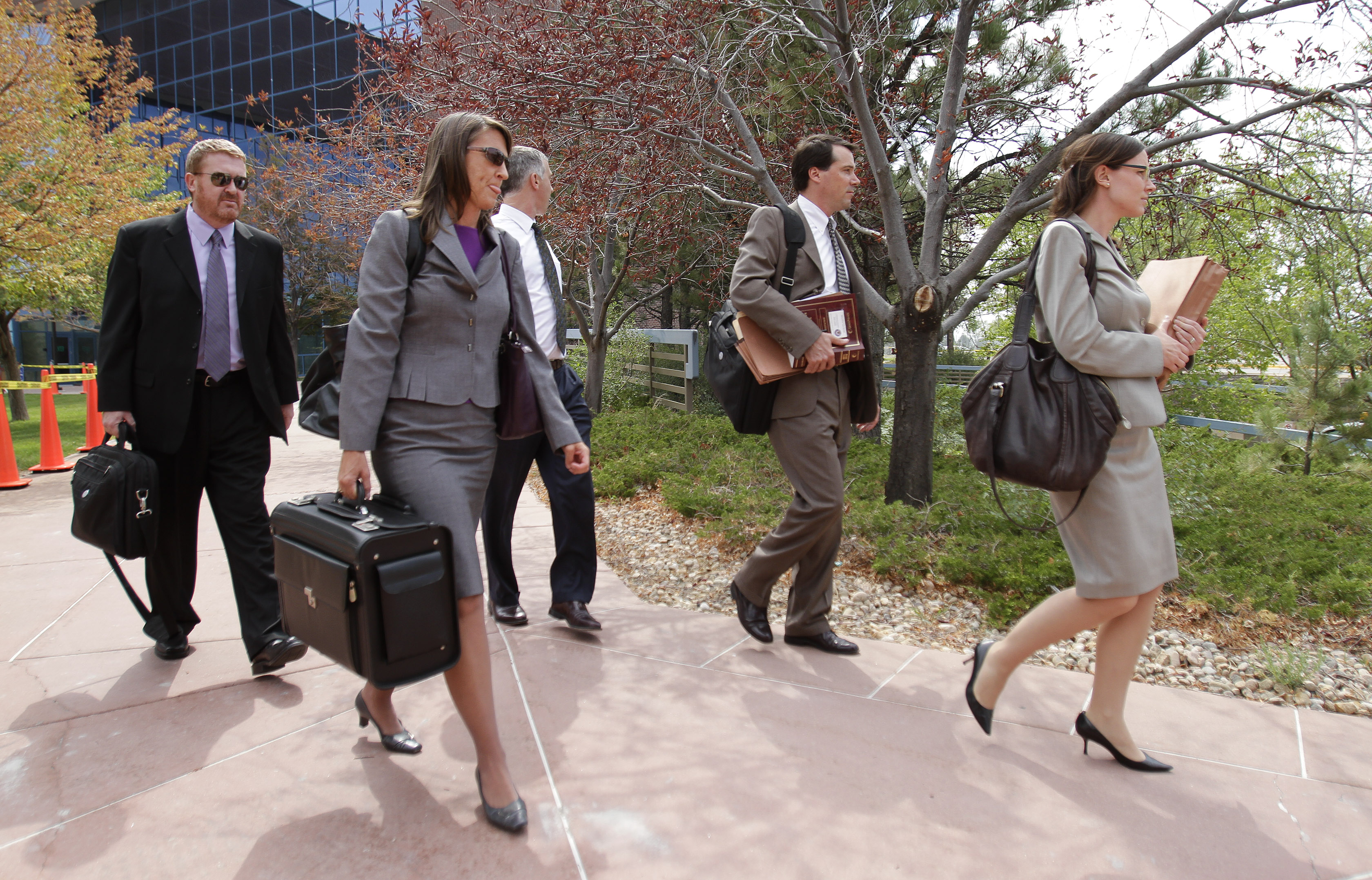 <p>Public defenders walk with the defense team as they leave the Arapahoe County courthouse after a motions hearing for Aurora shooting suspect James Holmes on Thursday Aug. 9, 2012.</p>