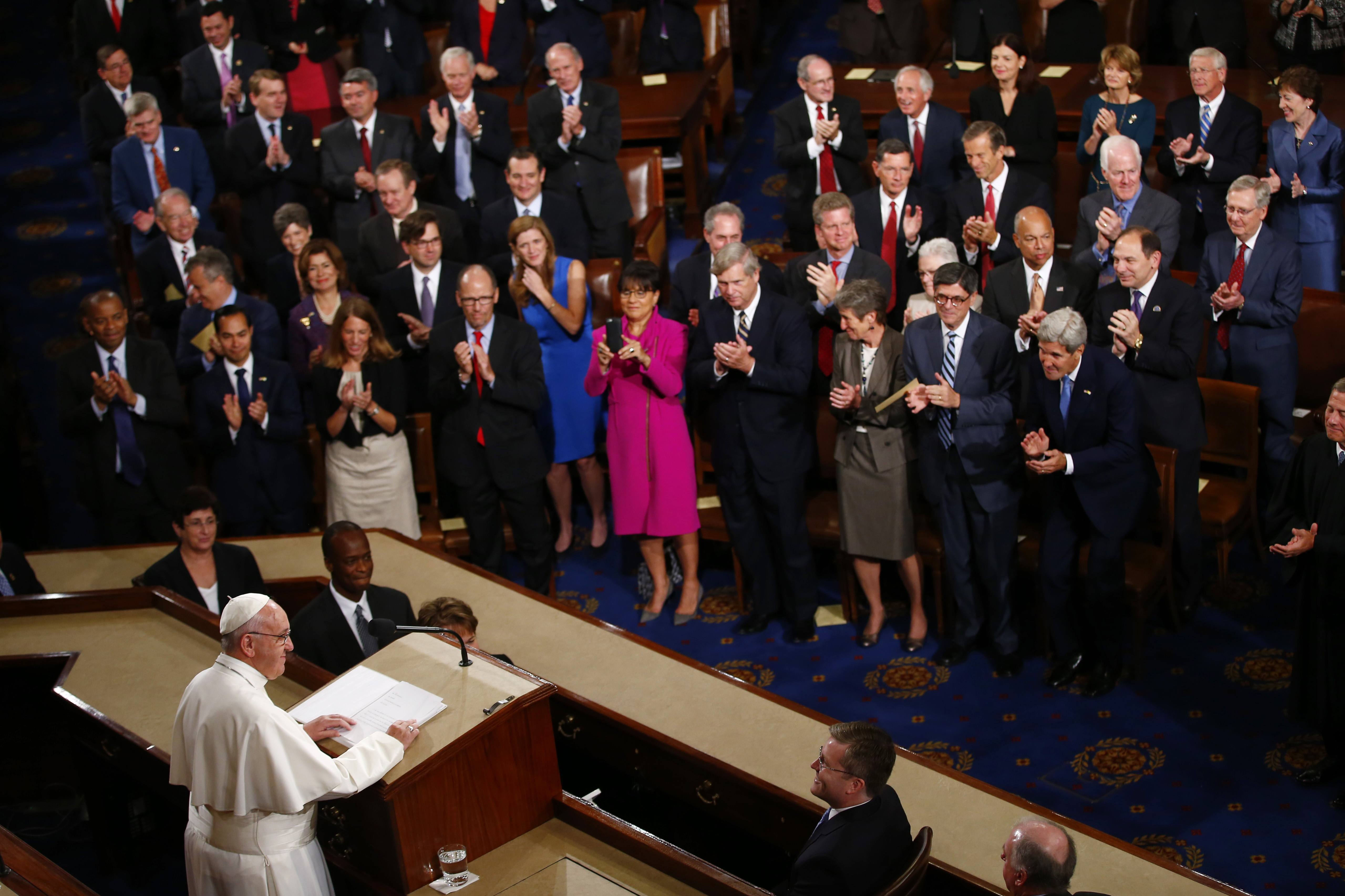 <p>Pope Francis listens to applause as he addresses a joint meeting of Congress on Capitol Hill in Washington, Thursday, Sept. 24, 2015, making history as the first pontiff to do so.</p>