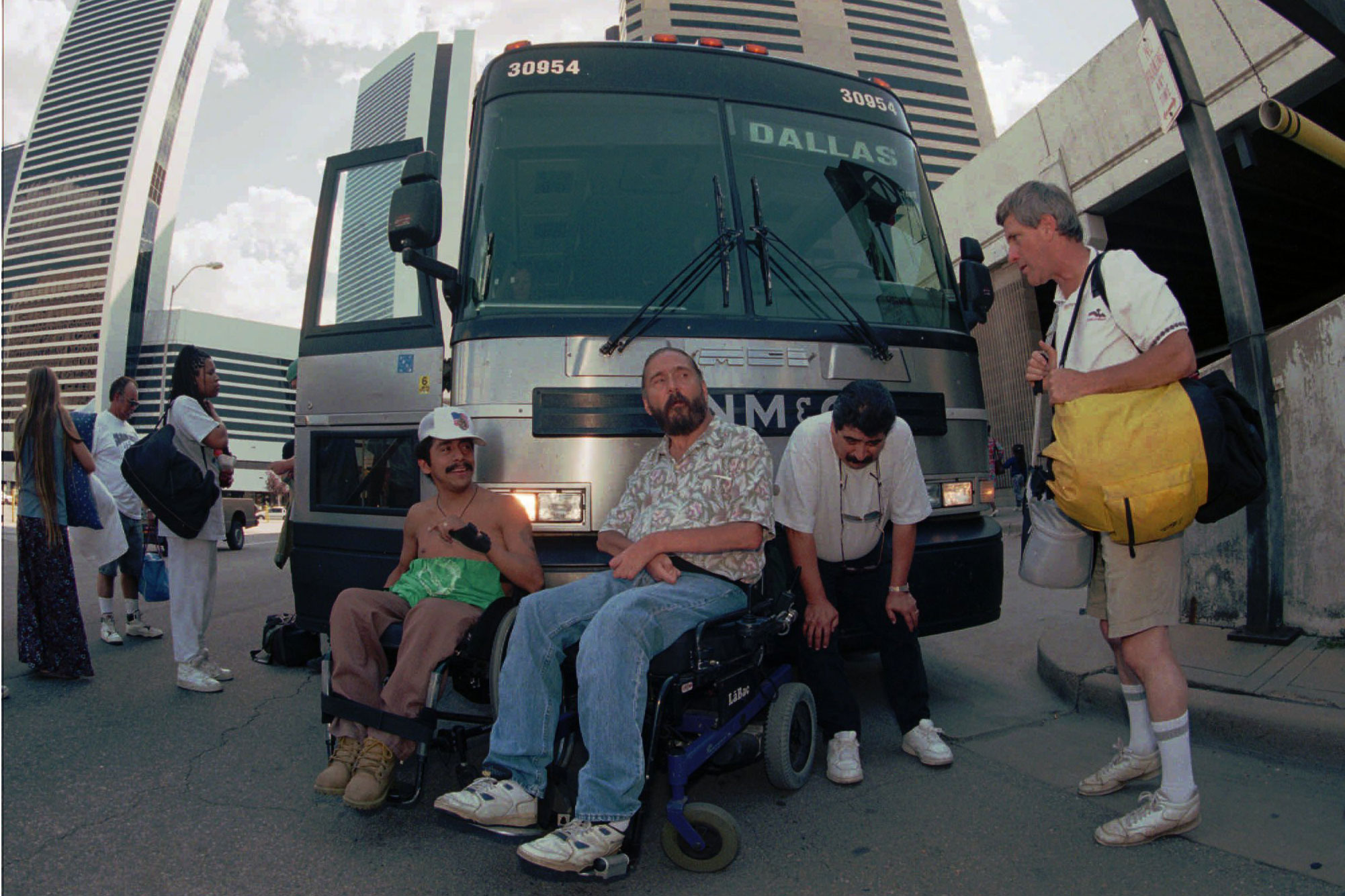 <p>Protesters Gil Casarez, left, and Michael Auberger, center, block an inbound Greyhound bus from entering the terminal in downtown Denver with the help of Beto Barrera of Chicago on Friday, Aug. 8, 1997. The protest was staged by ADAPT, which stands for American Disabled for Accessible Public Transport, to call attention to Greyhound's failure to equip new buses with lifts.</p>
