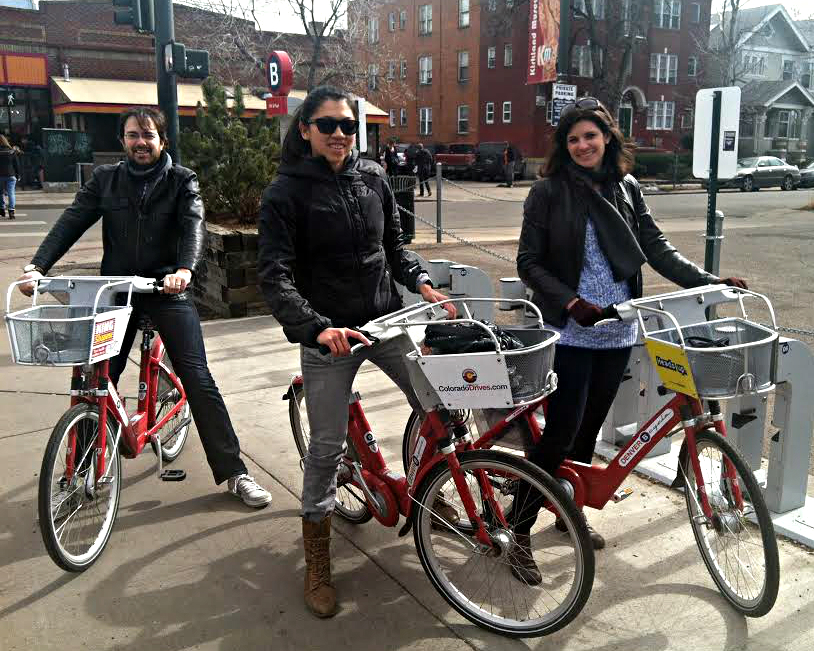 <p>Chris Moody, Carena Church and Nicole Moody are ready to take a spin on a B-Cycle on 13th Avenue in Denver. The Moodys are from California and were in town a few days visiting their friend Church, who lives in Denver. Church says she rides a bike instead of driving as much as she can.</p>