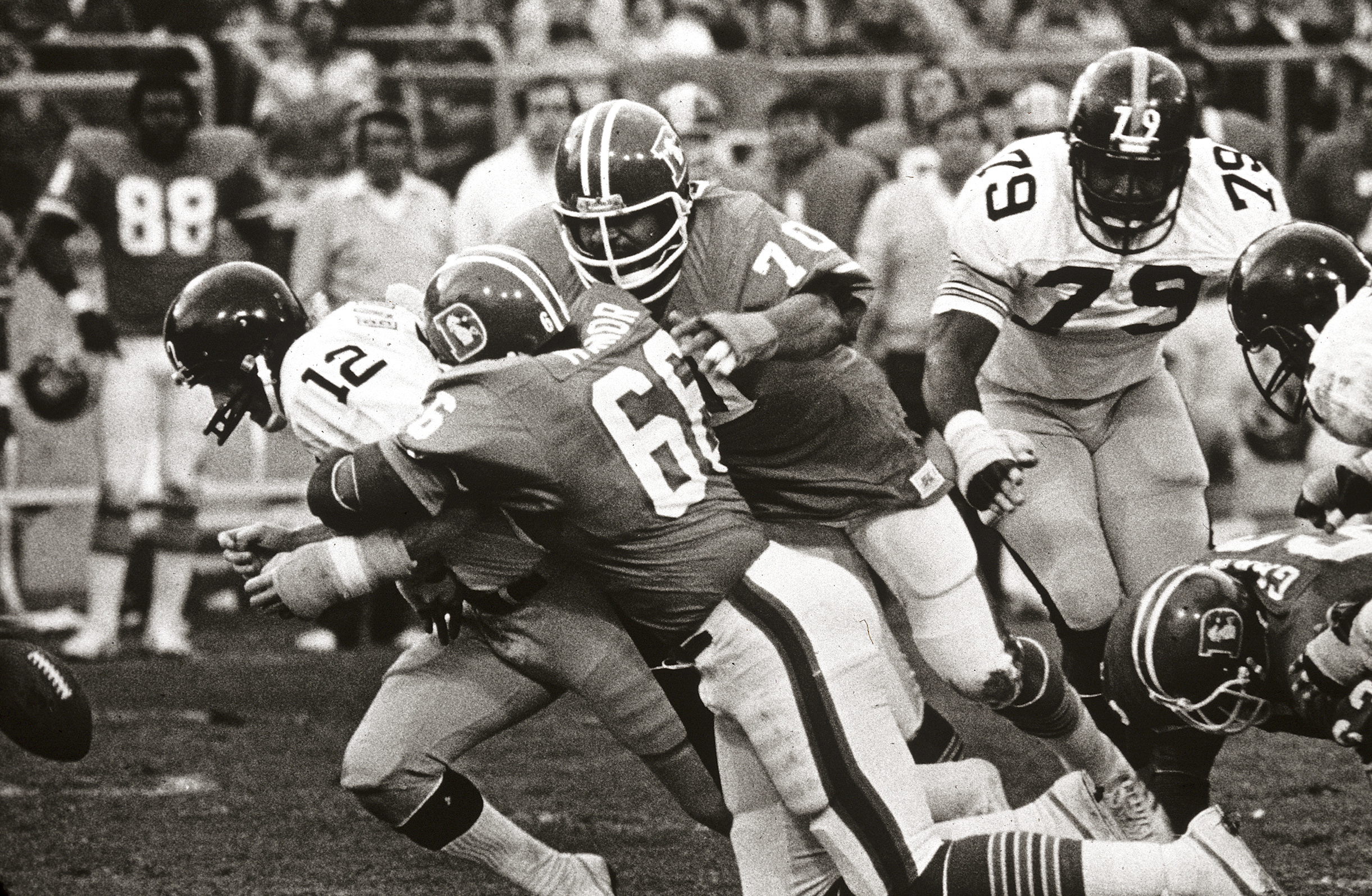 <p>Steelers quarterback Terry Bradshaw is sacked by Denver's defense during the 1977 season.</p>