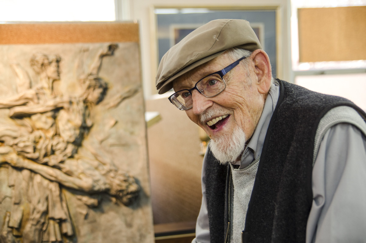 <p>Muralist Eric Bransby, 98, smiles inside his home on Tuesday, Dec. 2, 2014.</p>