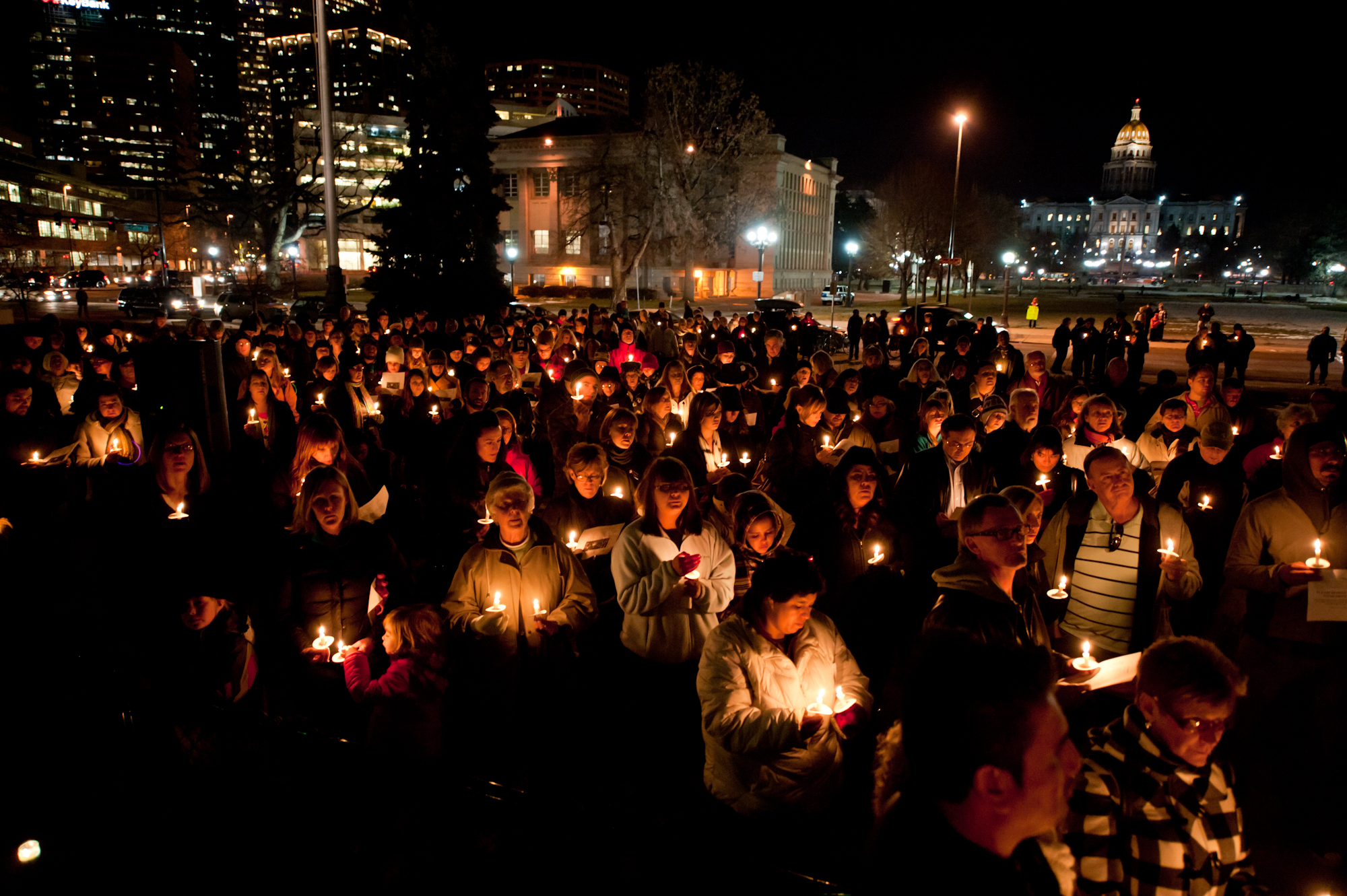 <p>People gather for a recent vigil to remember homeless people who have died in Colorado in the past year.</p>