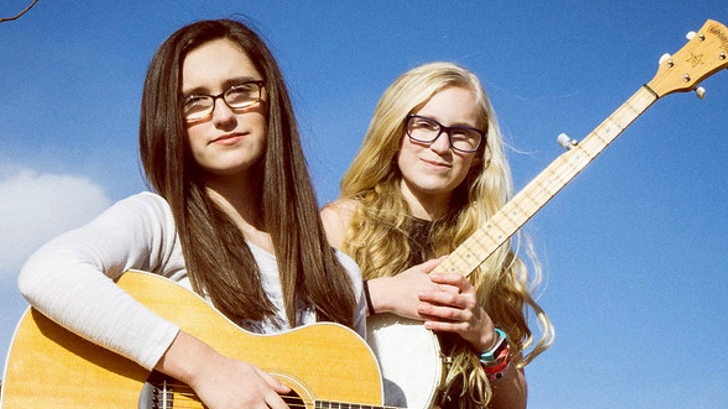 Megan, left, and Maddie, right, of Parker, Colorado. They perform bluegrass as the Cody Sisters.