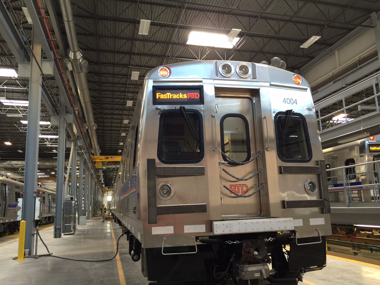 <p>One of RTD's new commuter rail cars waits in storage.</p>
