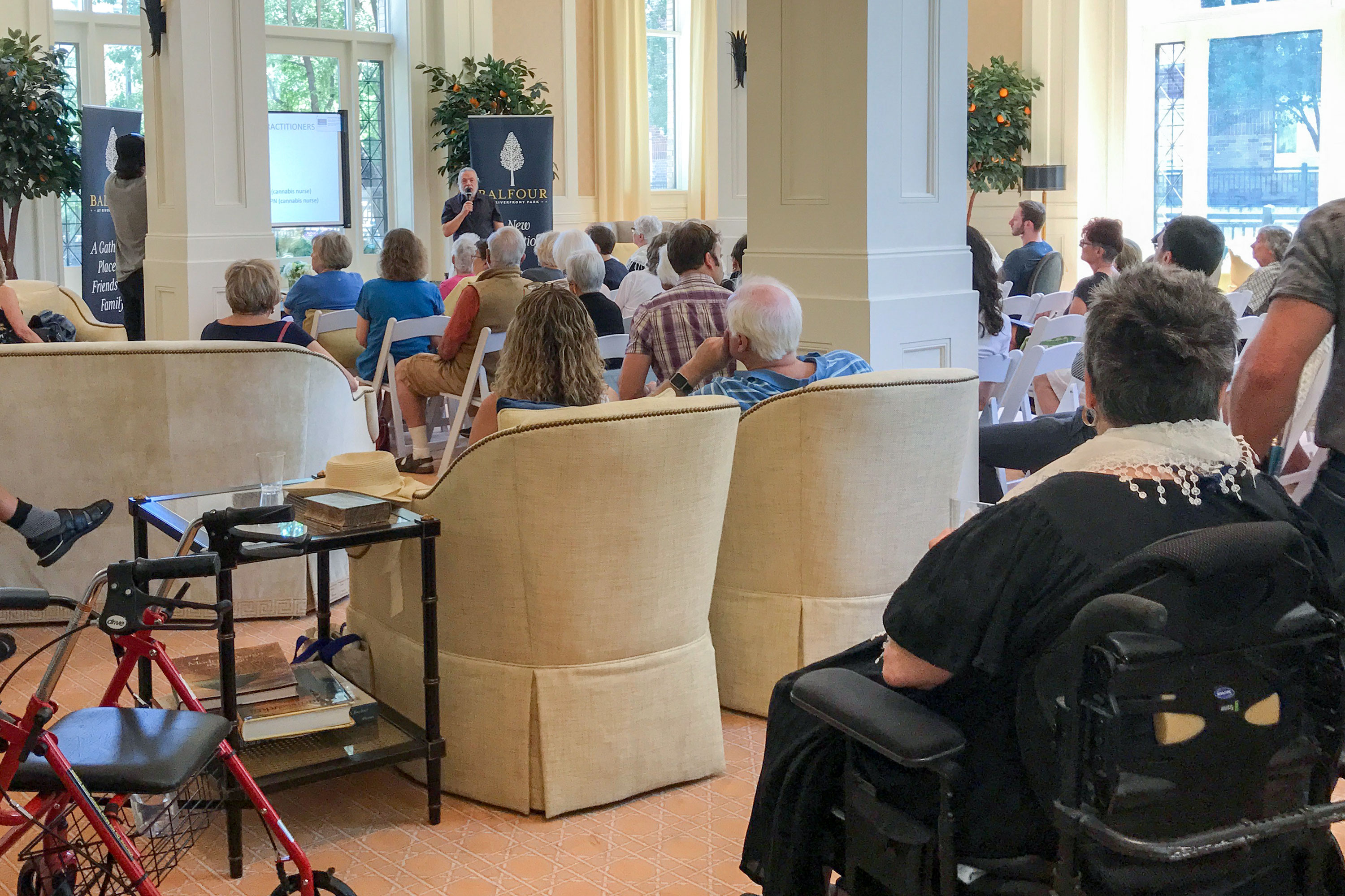 """<p>Residents in Balfour's Riverfront Park retirement community in downtown Denver fill the building's spacious lounge to hear Dr. Joe Cohen's seminar, """"Cannabis 101 for Seniors.""""</p>"""