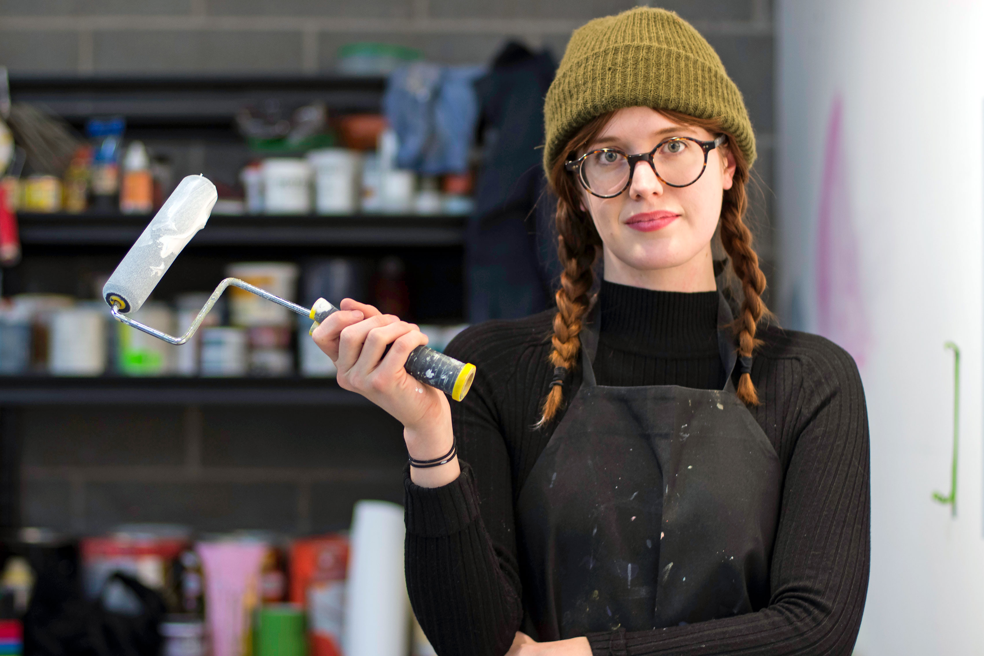 <p>Artist Molly Bounds, who lives at the Juice Church DIY space, paints in her studio at RedLine Contemporary Art Center, in Denver, Colo.</p>