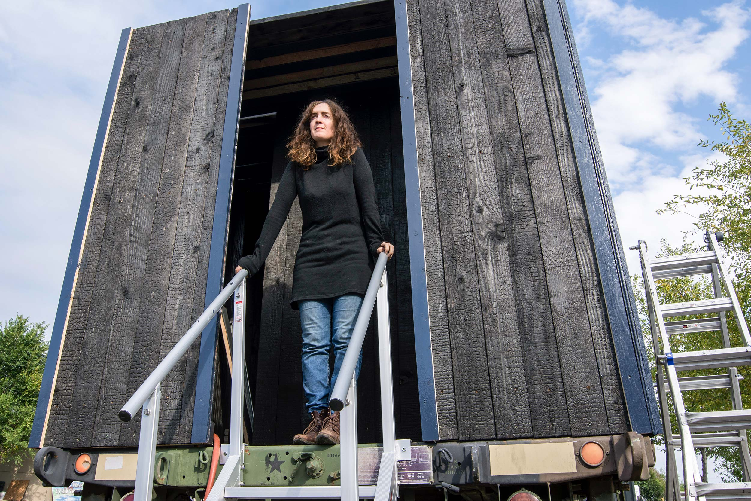 "<p>New York City artist Mary Mattingly stands inside her installation titled ""Everything At Once"" in Boulder on Friday, Sept. 29, 2017.</p>"