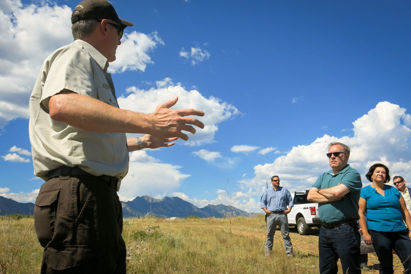<p>Dave Lucas, left, with the U.S. Fish and Wildlife Service talks to Environmental Protection Agency Administrator Andrew Wheeler, right, on the Rocky Flats National Wildlife Refuge north of Denver.</p>