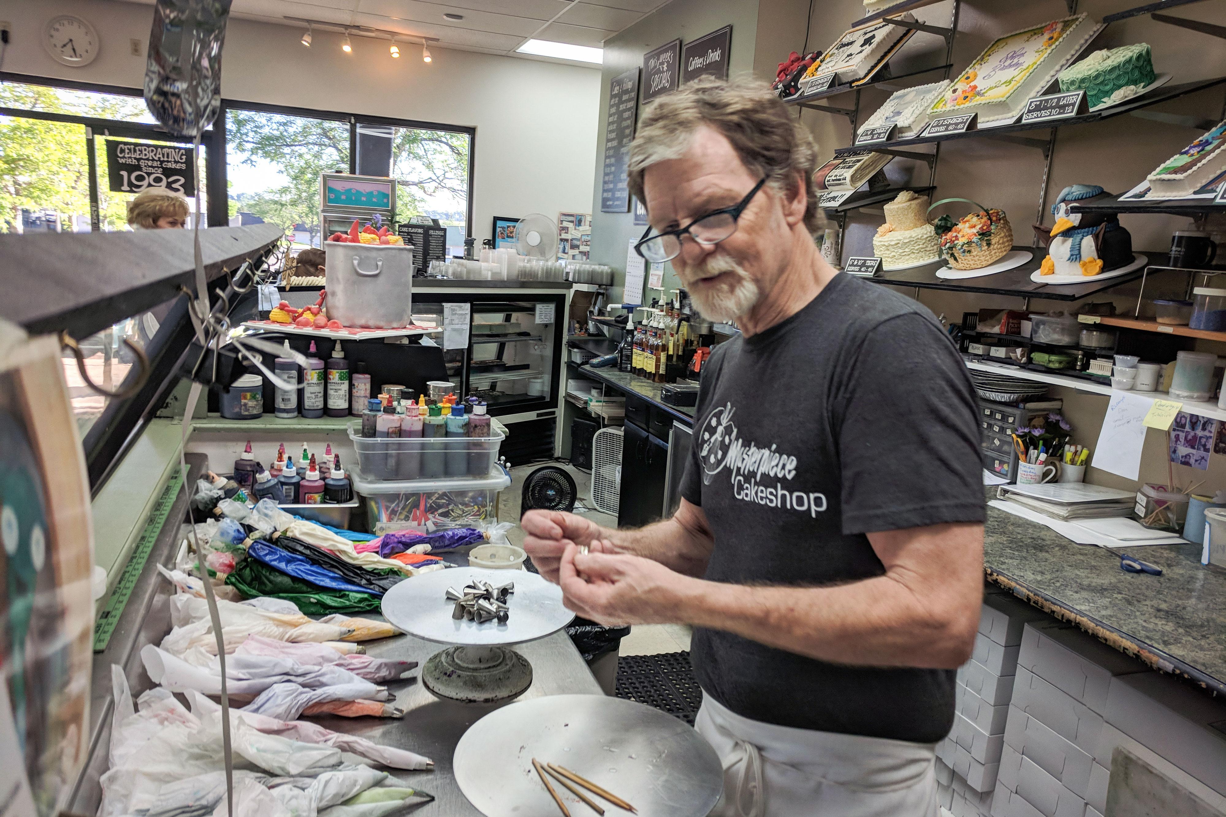<p>Baker Jack Phillips at work at Masterpiece Cakeshop, June 8, 2018.</p>