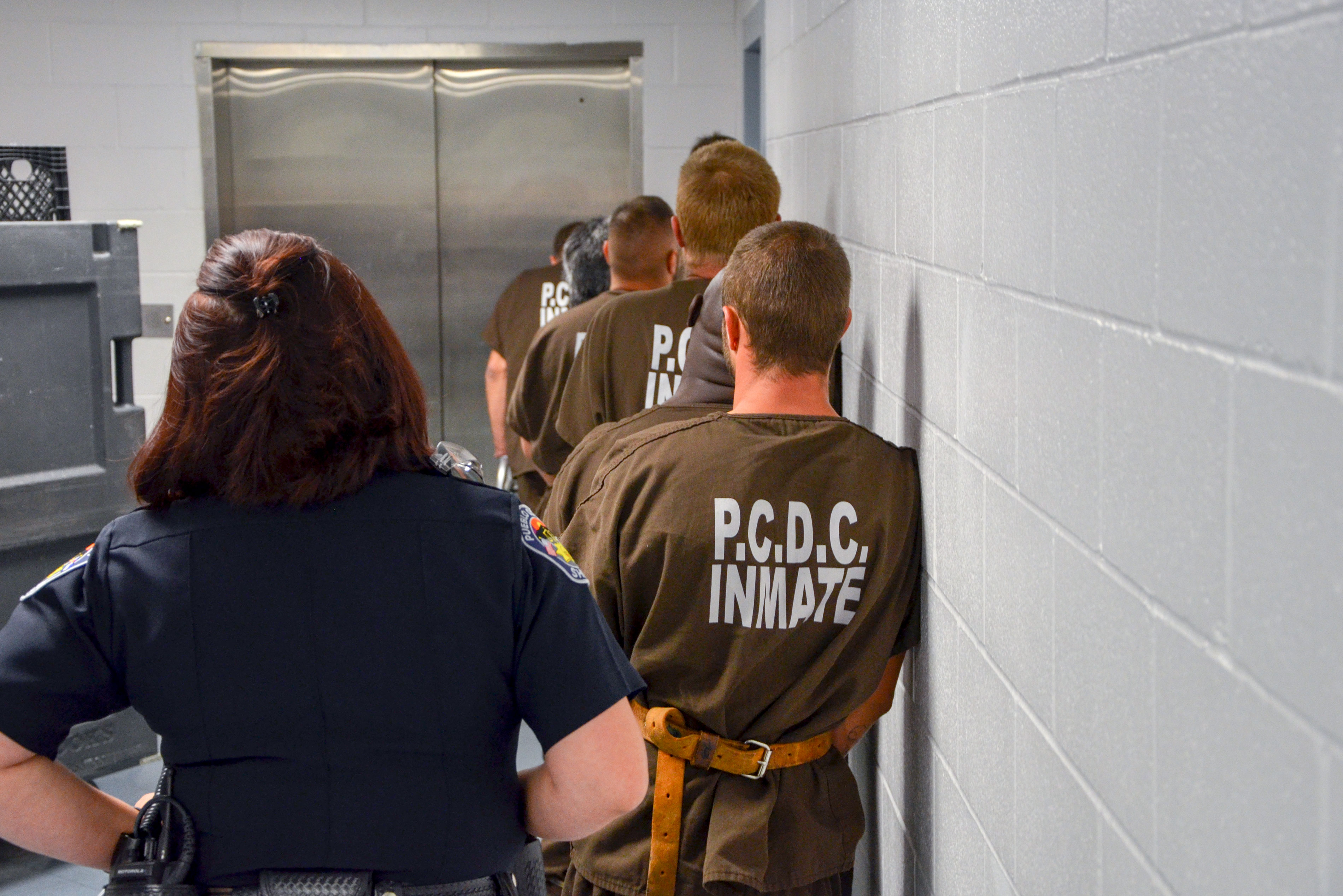 <p>Inmates headed for court inside the Pueblo County Jail.</p>