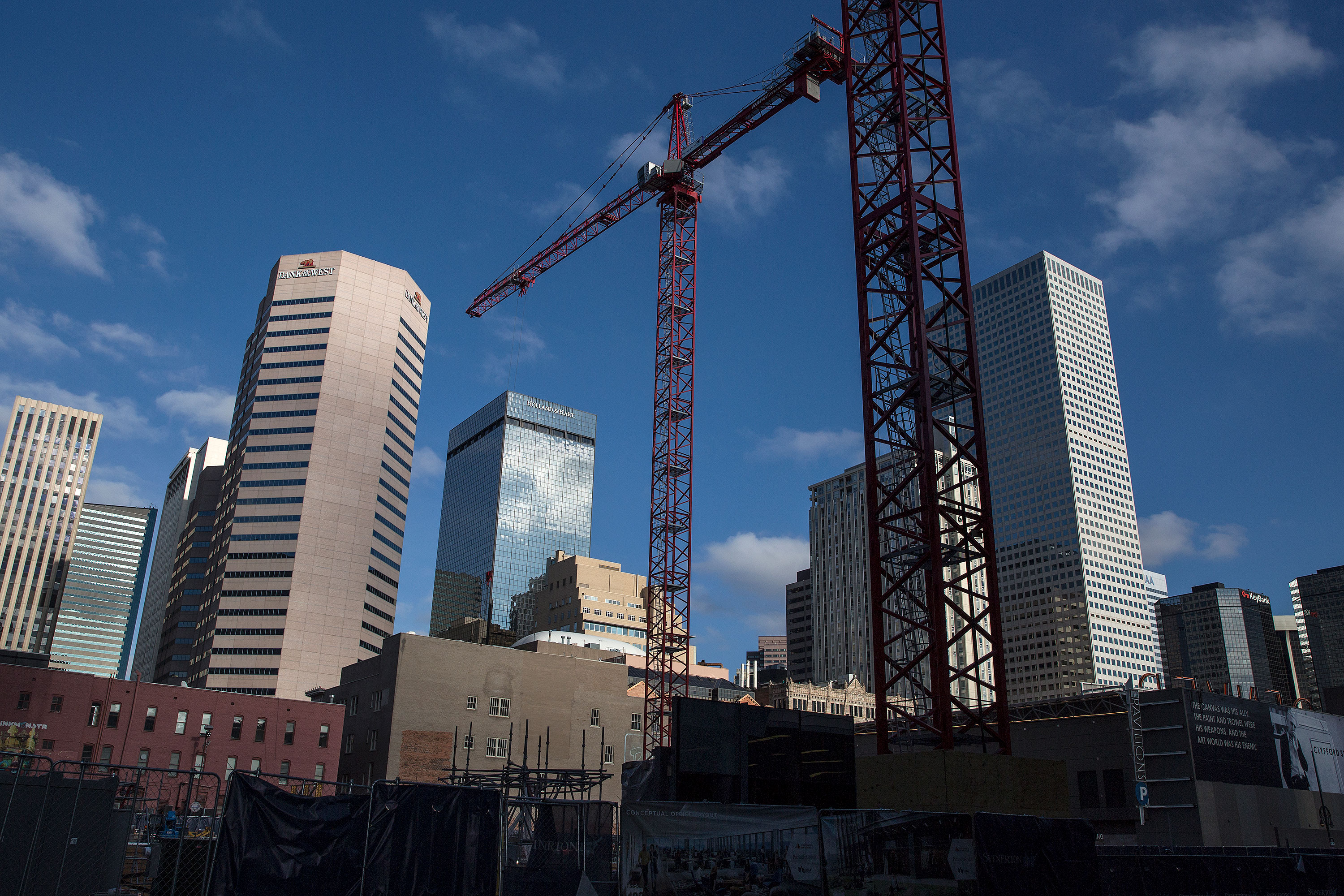 Construction cranes in downtown Denver Friday Dec. 28, 2018.