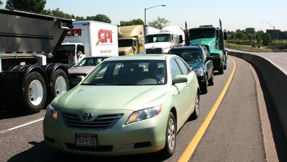 <p>Trucks and cars sit in a traffic jam on I-70 West in Denver.</p>