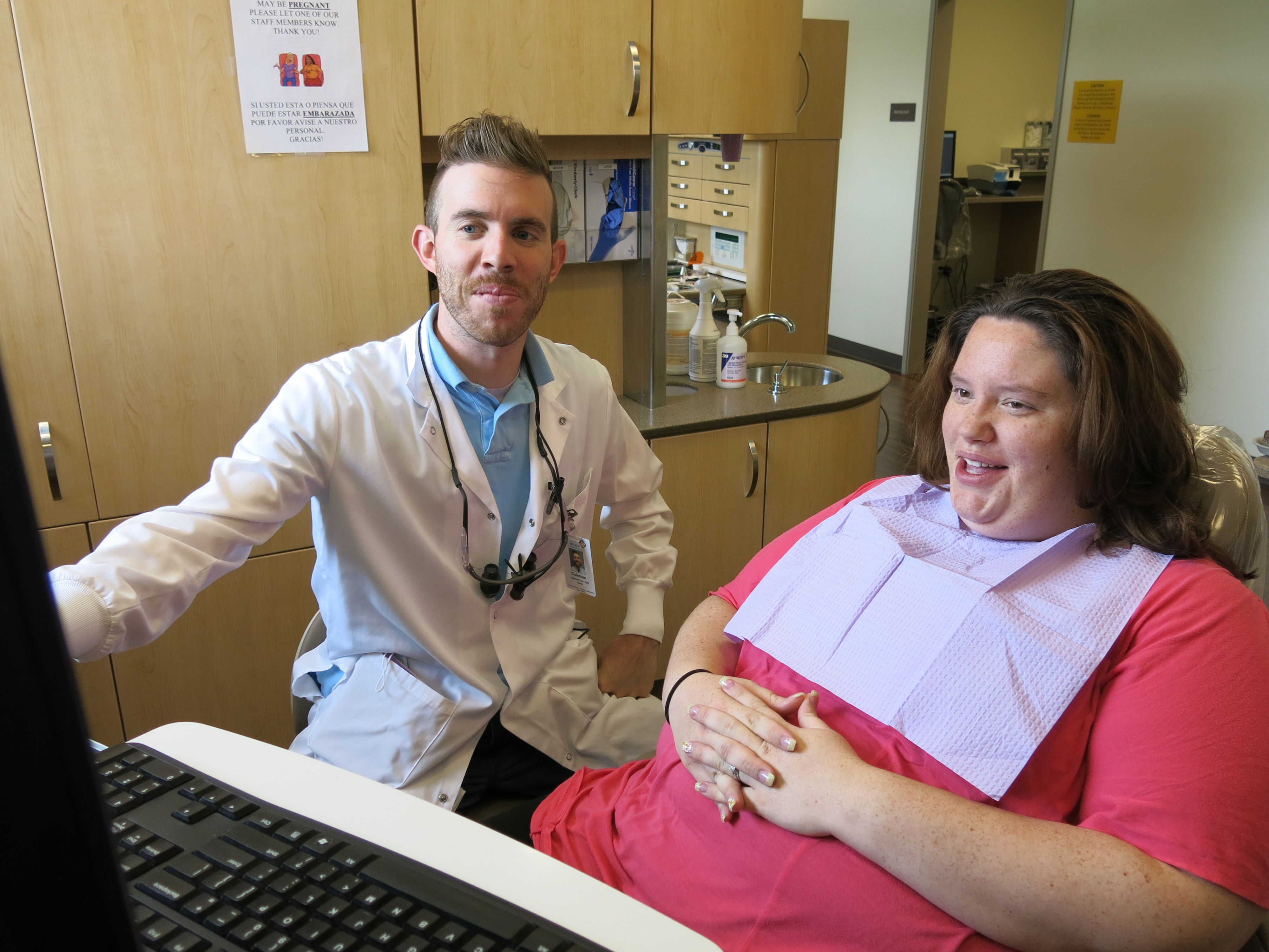 <p>Dr. Coleman Eich, a dentist with Clinica Family Health Services in Thorton, and patient Nicole Castillo, who recently qualified for expanded Mediaid dental coverage.</p>