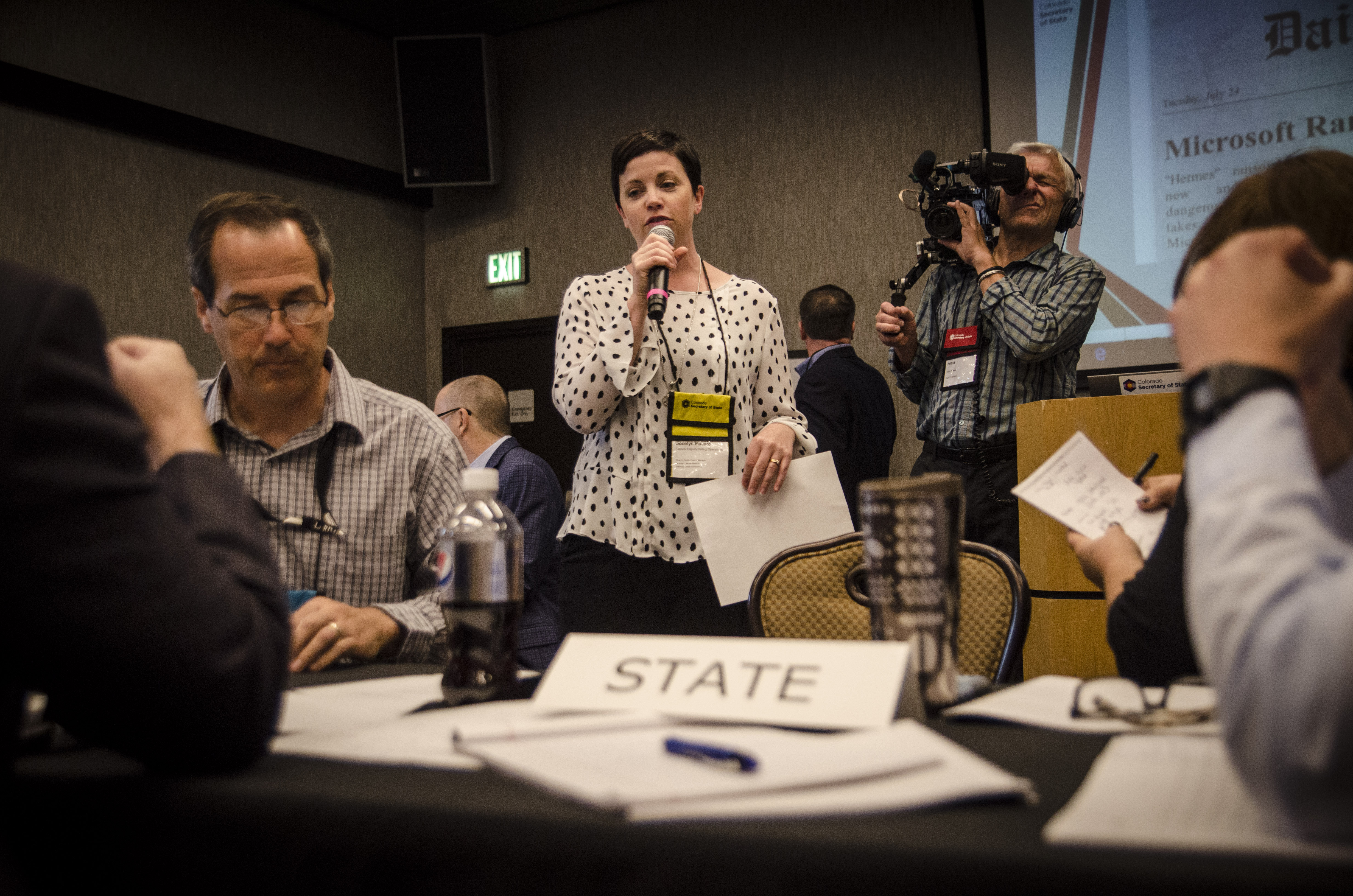 """<p>Jocelyn Bucaro, with Denver's Elections Division, participates in a """"war game"""" meant to train elections officials on how to deal with various disasters and attacks at a hotel in suburban Denver, Thursday, Sept. 6, 2018.</p>"""