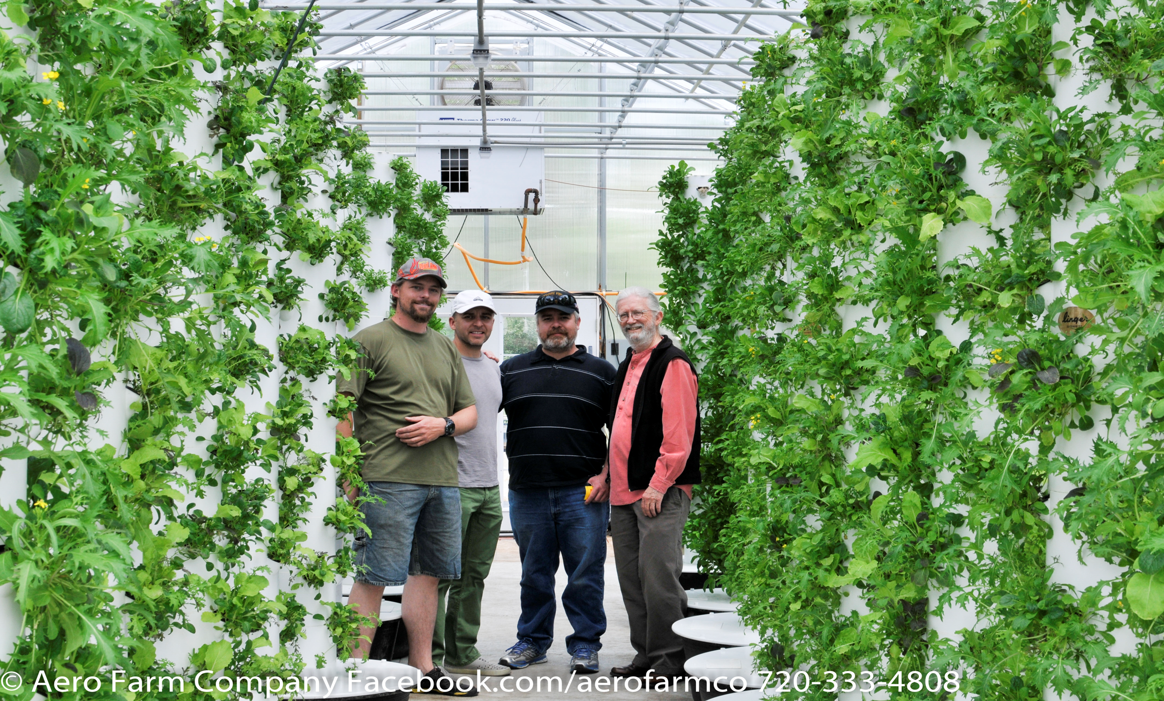 <p>Evan Premer, owner of Aero Farm Co. in Lakewood, Colo., gives a tour to farmers interested in vertical aeroponics.</p>