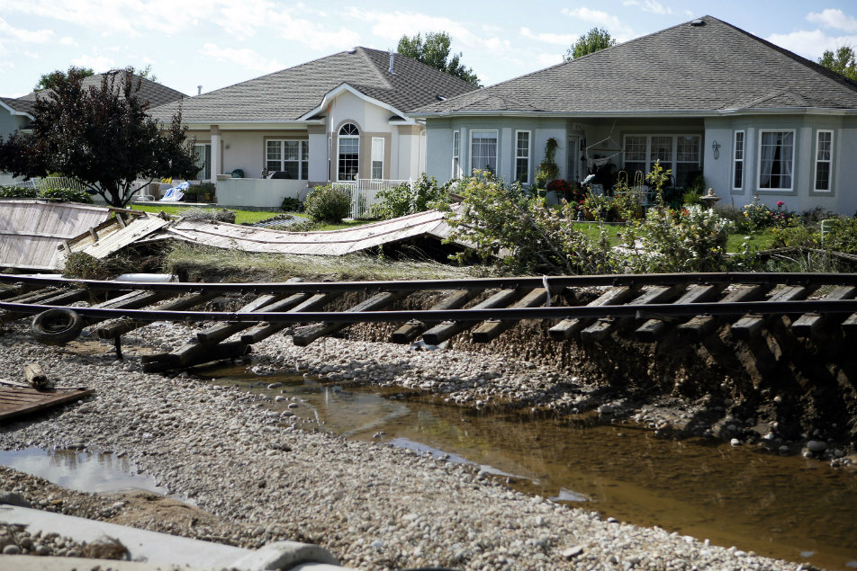 <p>Railroad tracks are undercut by flooding in Longmont, Colo., on Thursday, Sept. 19, 2013.</p>