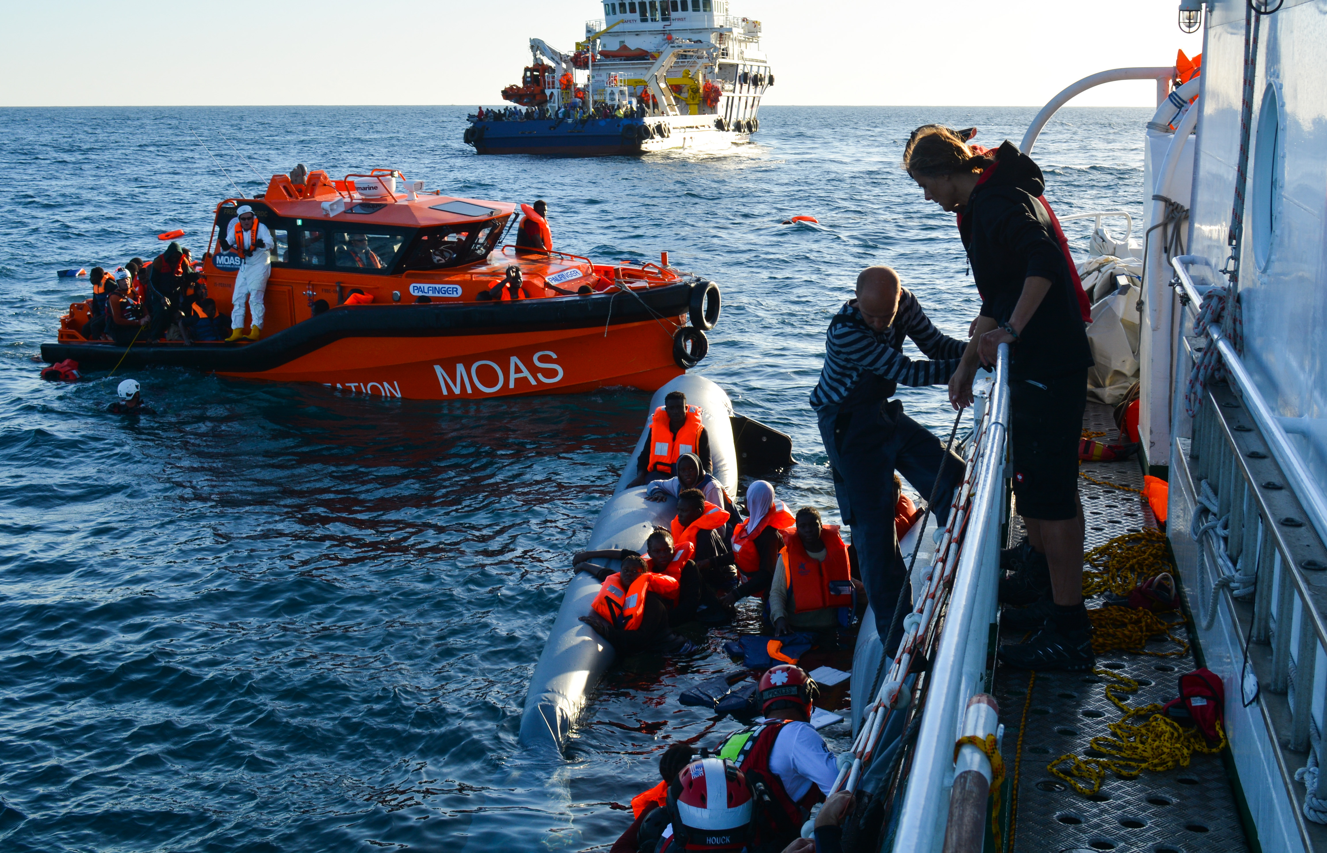 <p>Rescuers pull refugees from the Mediterranean Sea after their rubber boat capsized roughly 20 miles off the coast of Libya on Nov. 22, 2016. Overcrowded boats like this sink with some regularity, often with numerous fatalities.</p>