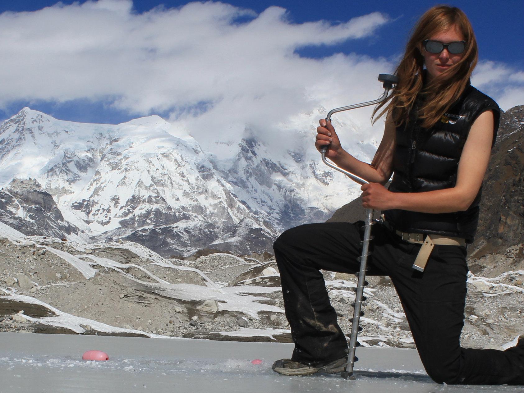 <p>Ulyana Horodyskyj drilling on a glacial ice lake to retrieve sensors on the Ngozumpa glacier in Nepal.</p>