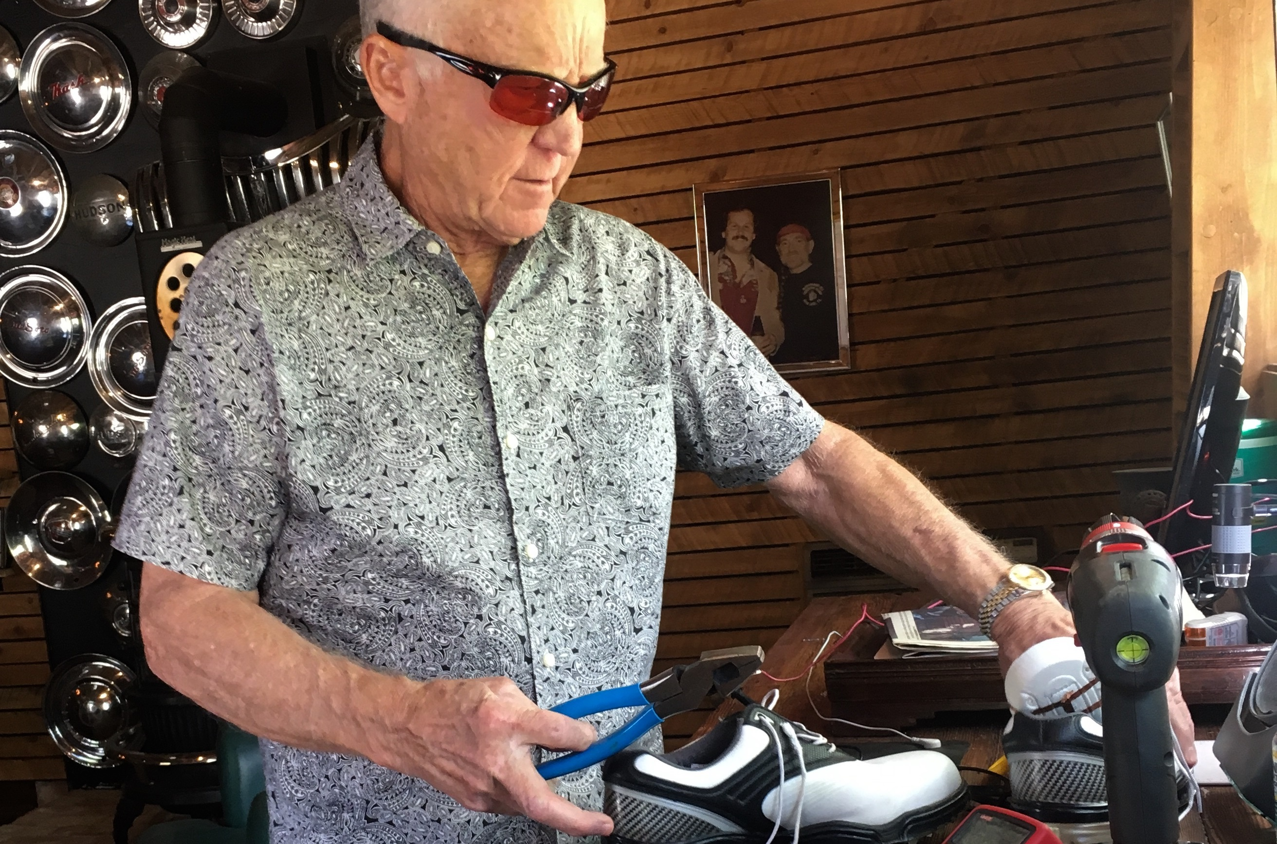 <p>Dr. Dick Fulton works on a new invention in his barn workshop.</p>
