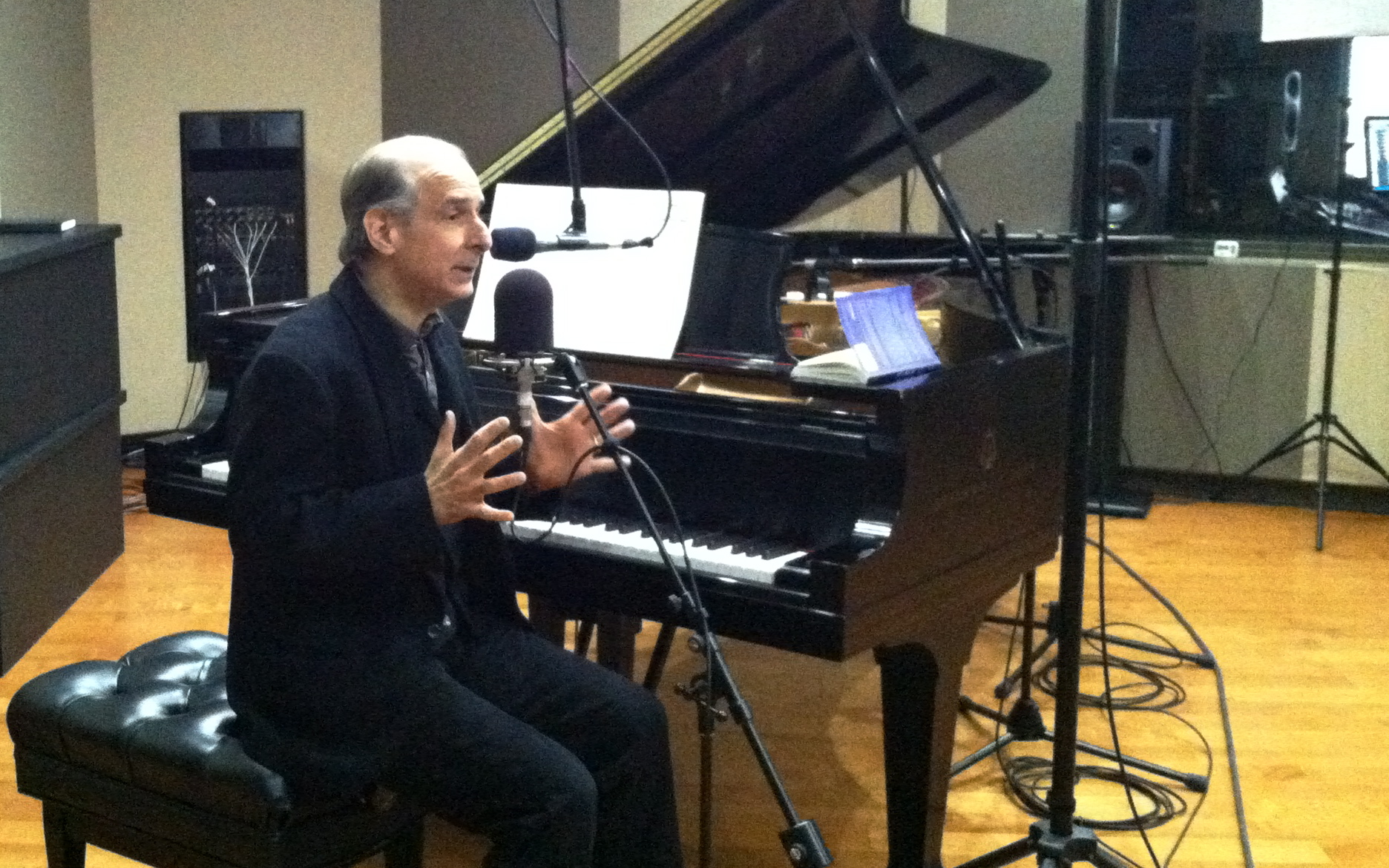 <p>Bruce Adolphe demonstrates exercises to stimulate the imagination at the grand piano in CPR's Performance Studio.</p>