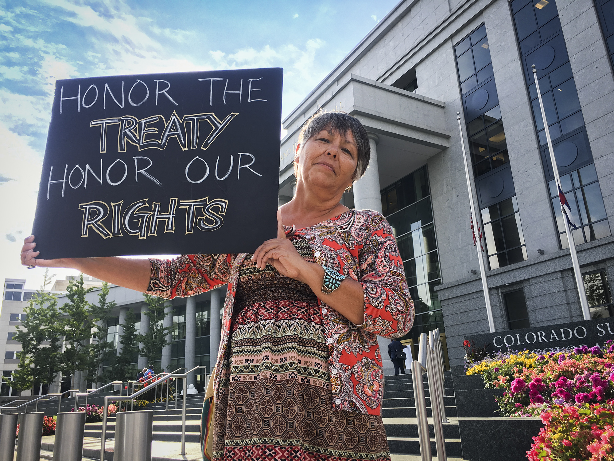 <p>Margaret Montañofrom San Luis, Colorado, stands outside the Colorado Supreme Court and Court of Appeals building in downtown Denver.</p>