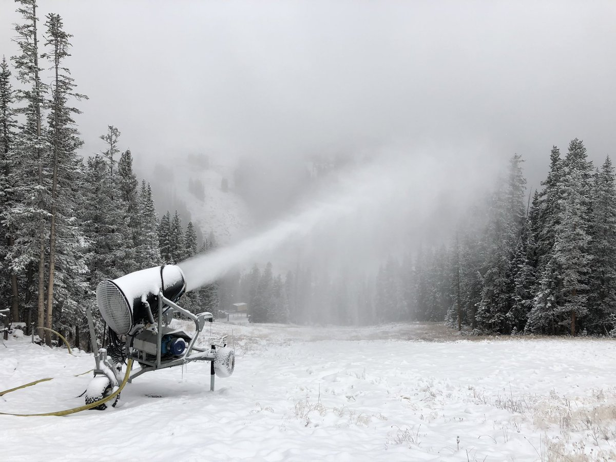 <p>A snowgun blasts out man-made snow at Loveland Ski Area on Monday, Oct. 8, 2018.</p>