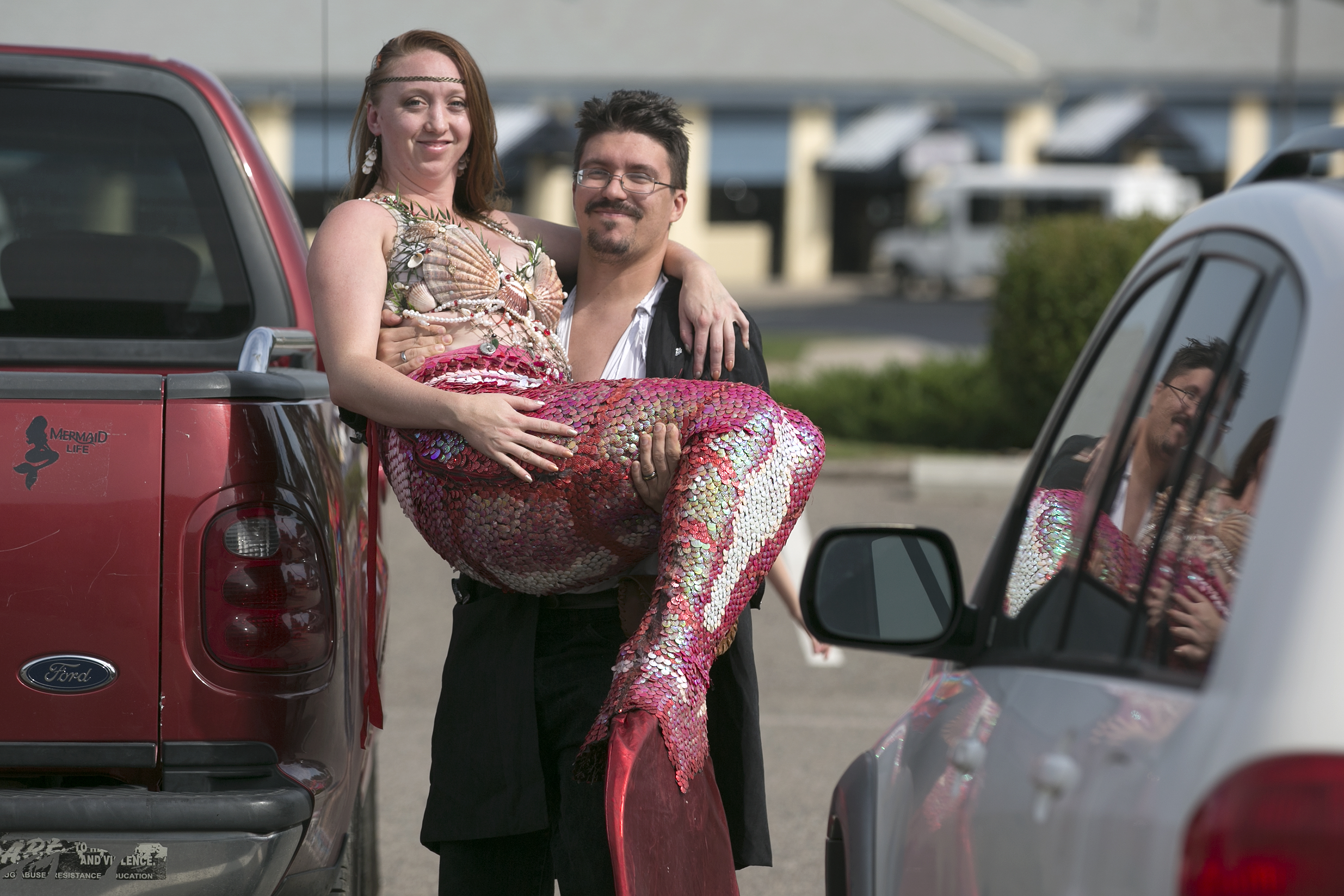 <p>Pixy Wright is founder of Pueblo's Mermaid Lagoon. And, because the tail prevents her from walking, she was carried into the CPR News studiosby herhusband, Bill Wright. And he is dressed as a pirate.</p>