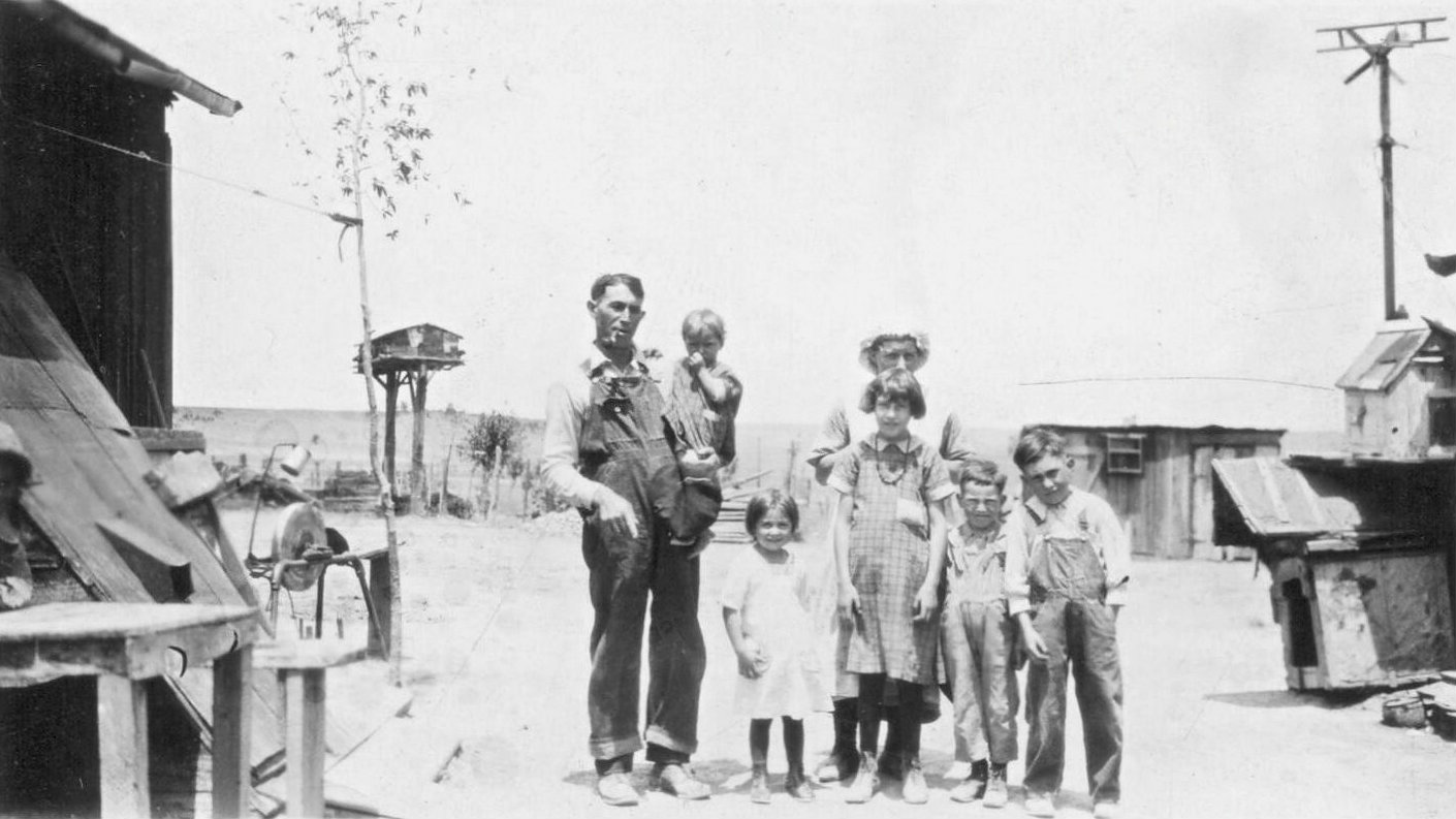 <p>Mary Petrucci stands behind her children Edna, Lucy, Frank, Joe while at the left, Thomas Petrucci holds the couple's baby Mary. This photo was taken around 1924 at the home Thomas built about mile south of the Ludlow Depot. </p>