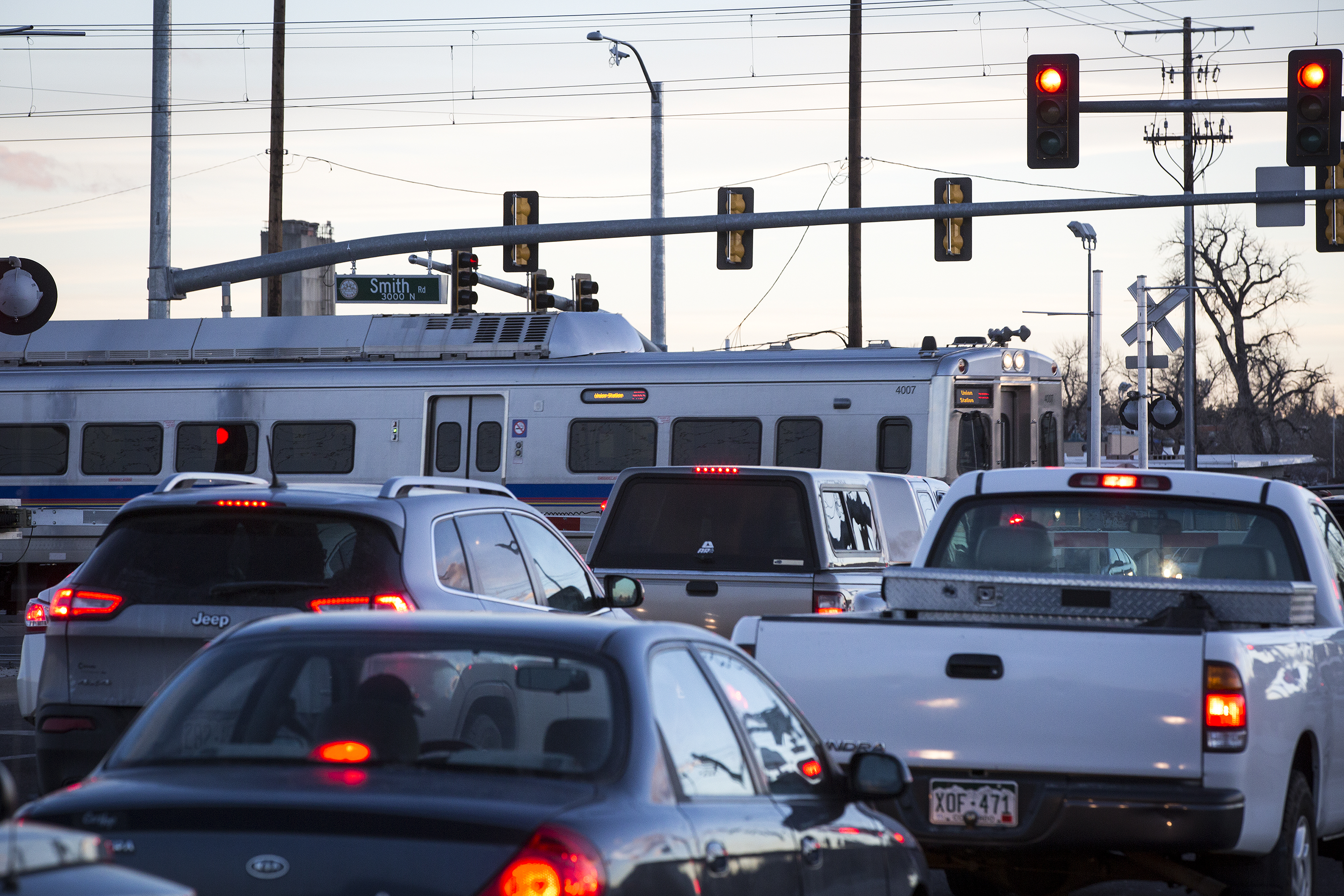 <p>As rush hour traffic waits, an A Line train crosses Chambers Road at Smith Road in Aurora On Monday, Jan. 7, 2018.</p>