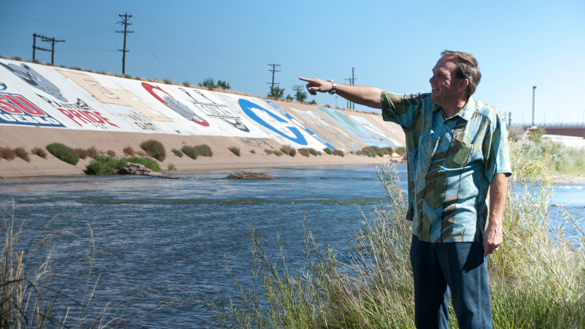 <p>Consulting engineer Kim Kock points out where some of the initial repairs will be made to the Arkansas River levee in Pueblo in a file photo.</p>
