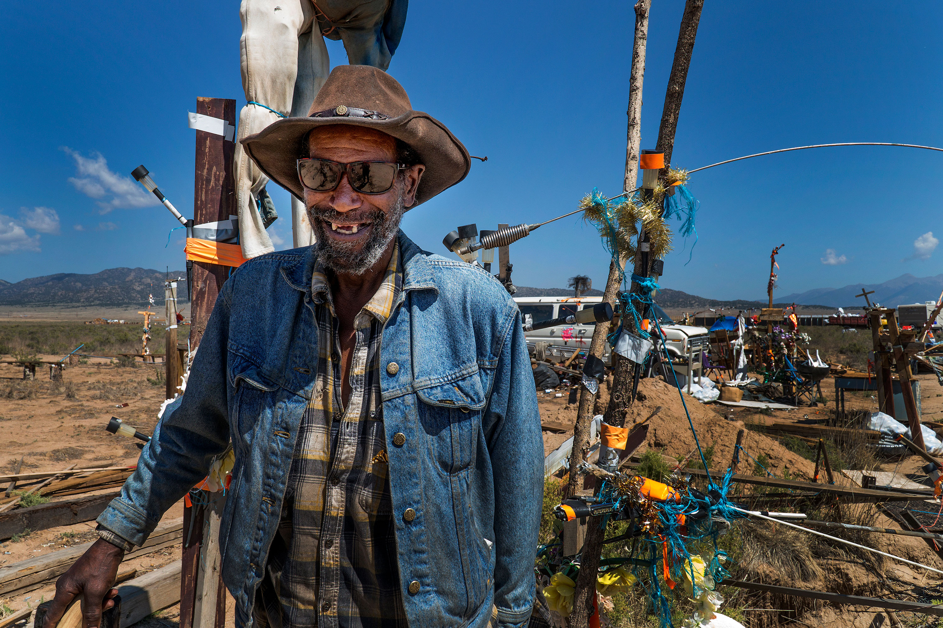 """<p>Roy L. Smith, known to many as """"Ramblin' Roy,"""" at Fort Roy at Royville, about 20 minutes outside of Saguache, on July 31, 2018. He said it took him a little more than a year to build this art compound.</p>"""