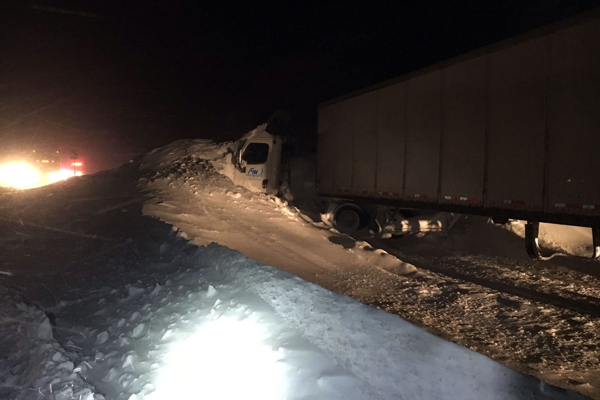 <p>A daycabsemi truck buried in a snow drift on Vail Pass, Jan. 10, 2017.</p>