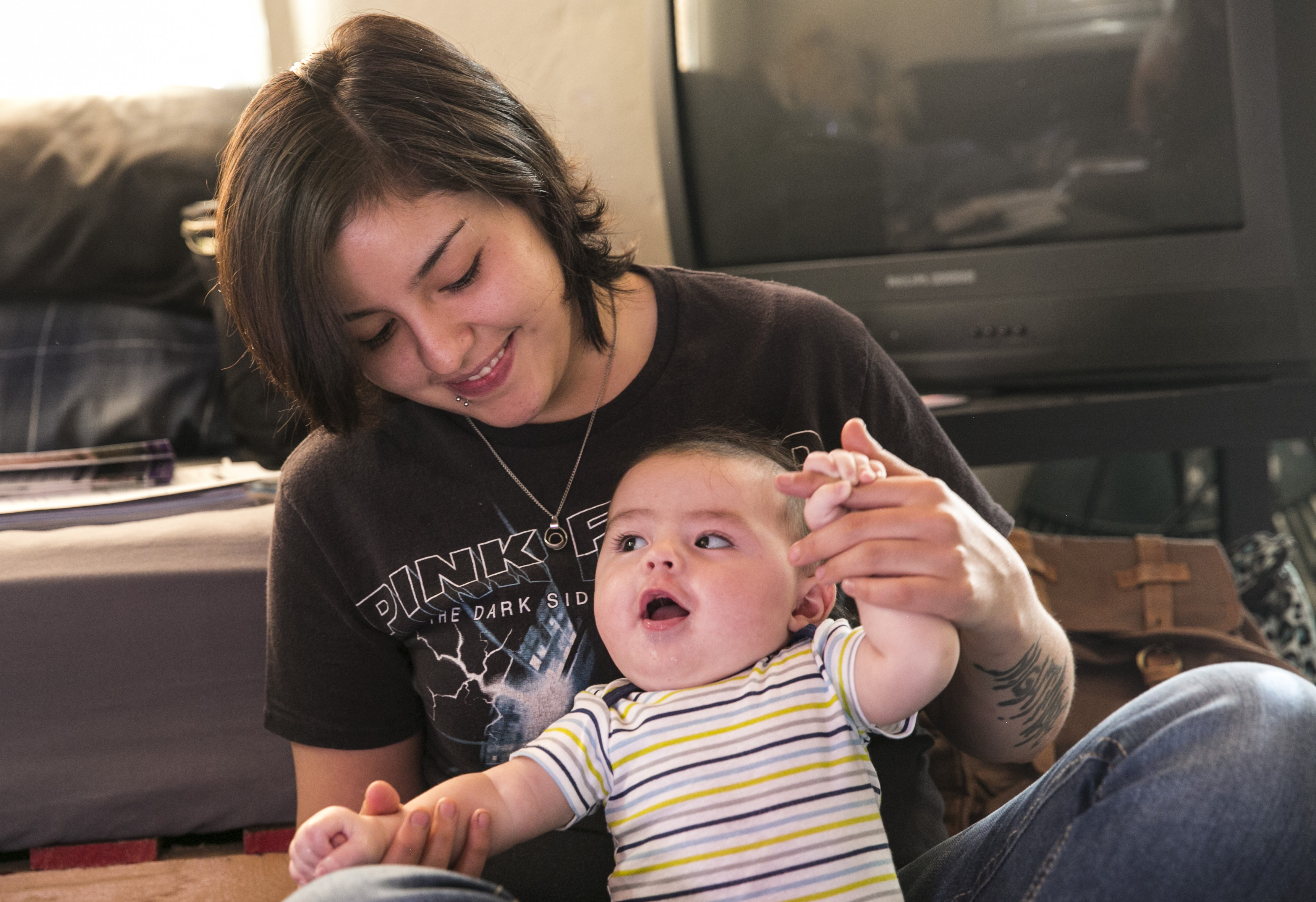 <p>Cecilia Sanchez plays with her son Jericho at her home in Alamosa, Colorado.</p>