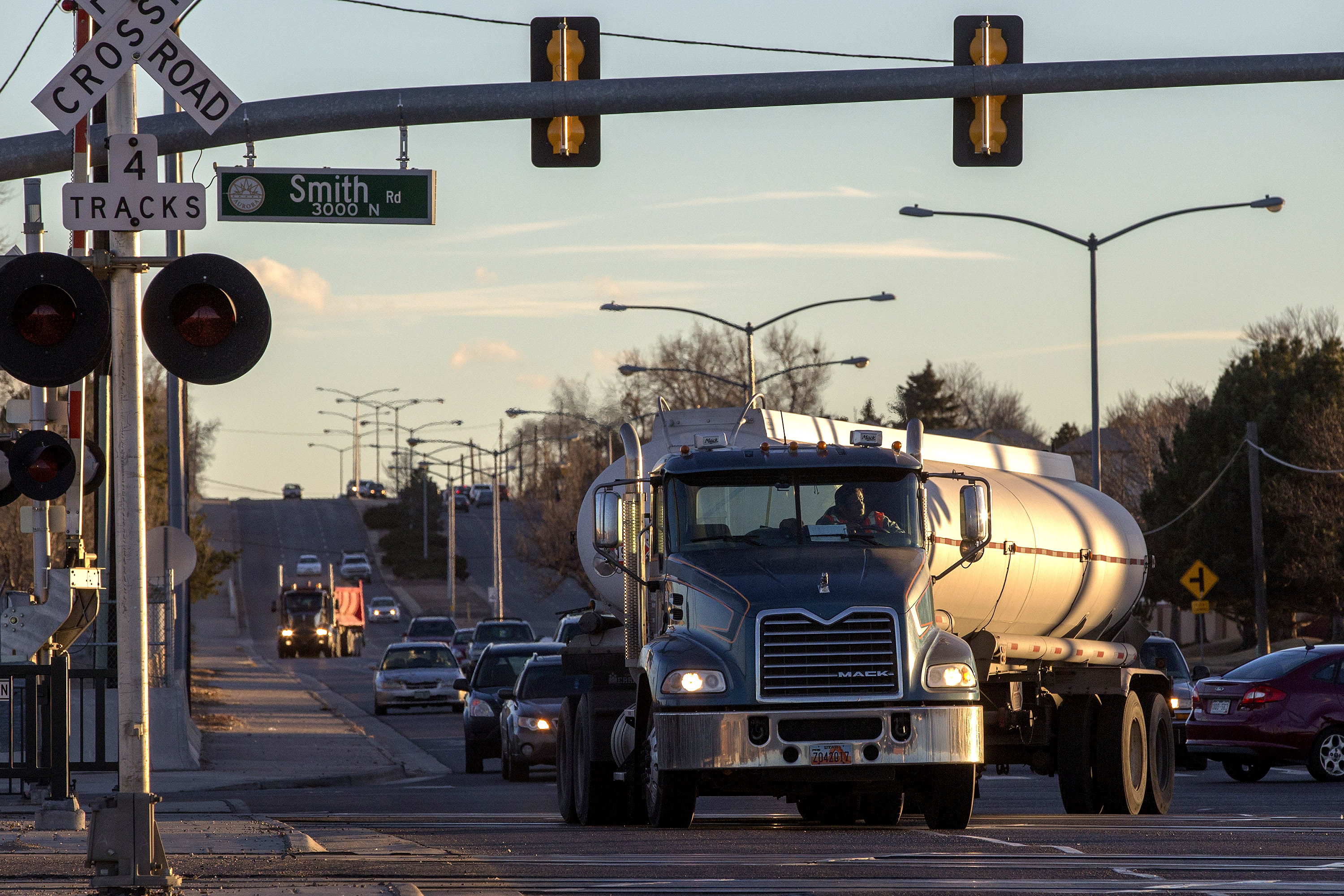 <p>A tanker truck cross the railroad tracks at Smith Road and Chambers Road in Aurora On Monday, Jan. 7, 2018.</p>